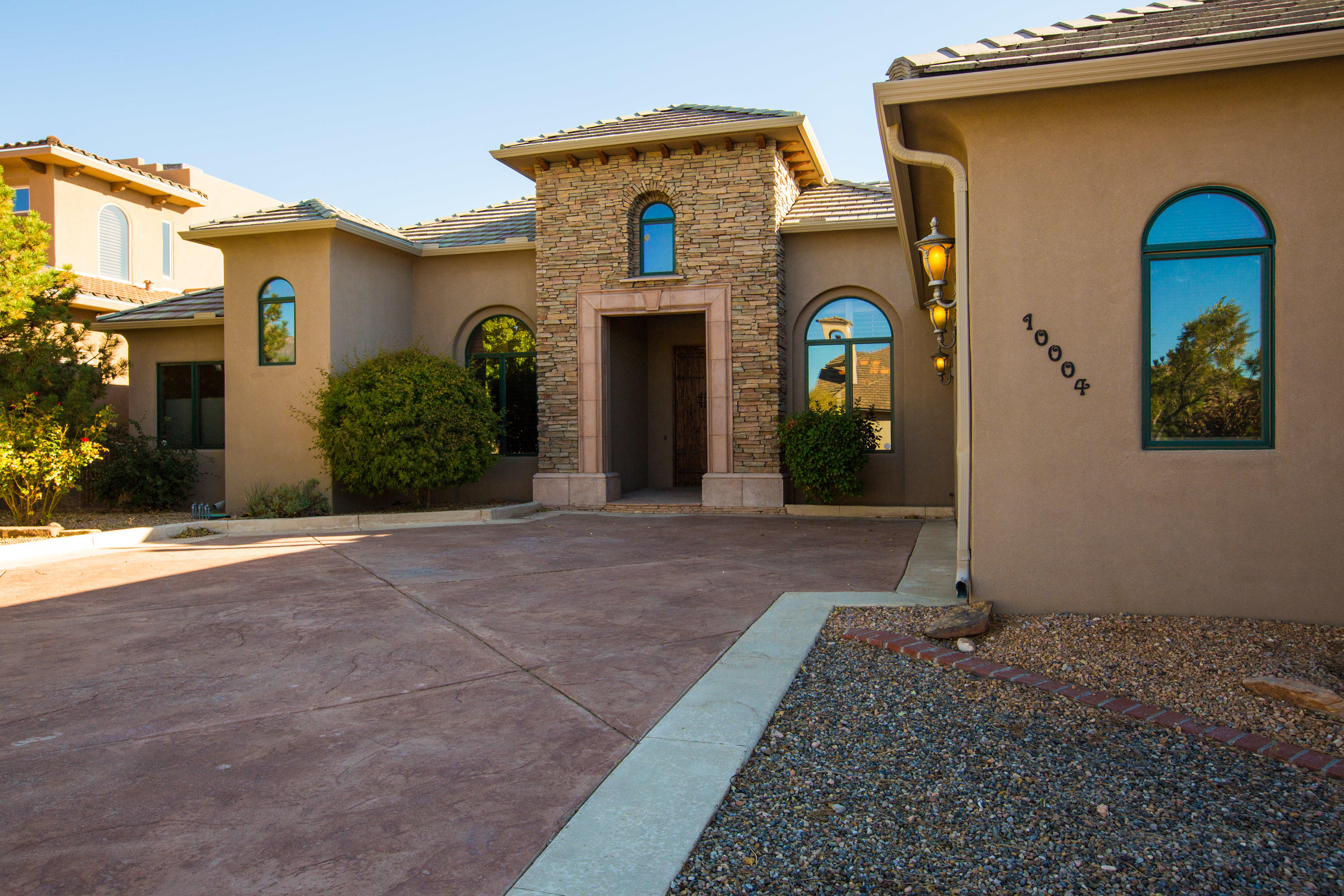 MUST SEE!- Beautiful Custom home in exclusive Ocotillo gated community in North ABQ Acres now Available! This custom built home features One Level, 4 bedrooms, 3.5 baths, and an attached 3 car garage. You'll enjoy cooking in the stunning ENTERTAINER'S DREAM of a KITCHEN w/ tons of granite slab countertop space, roomy pantry & bar which open to living area w/ views of the outside Water Feature. You'll find Custom ceilings throughout entire home, a DEN/FAMILY room that has a floor to ceiling stone FIREPLACE & double doors to the outdoor COVERED PATIO. Back inside you have large Travertine tile floors, formal & informal dining areas, an OFFICE/STUDY, large PRIVATE MASTER Bathroom w/ double sinks, soaking tub, separate shower and  walk-in closet. This gorgeous home has something for everybody!