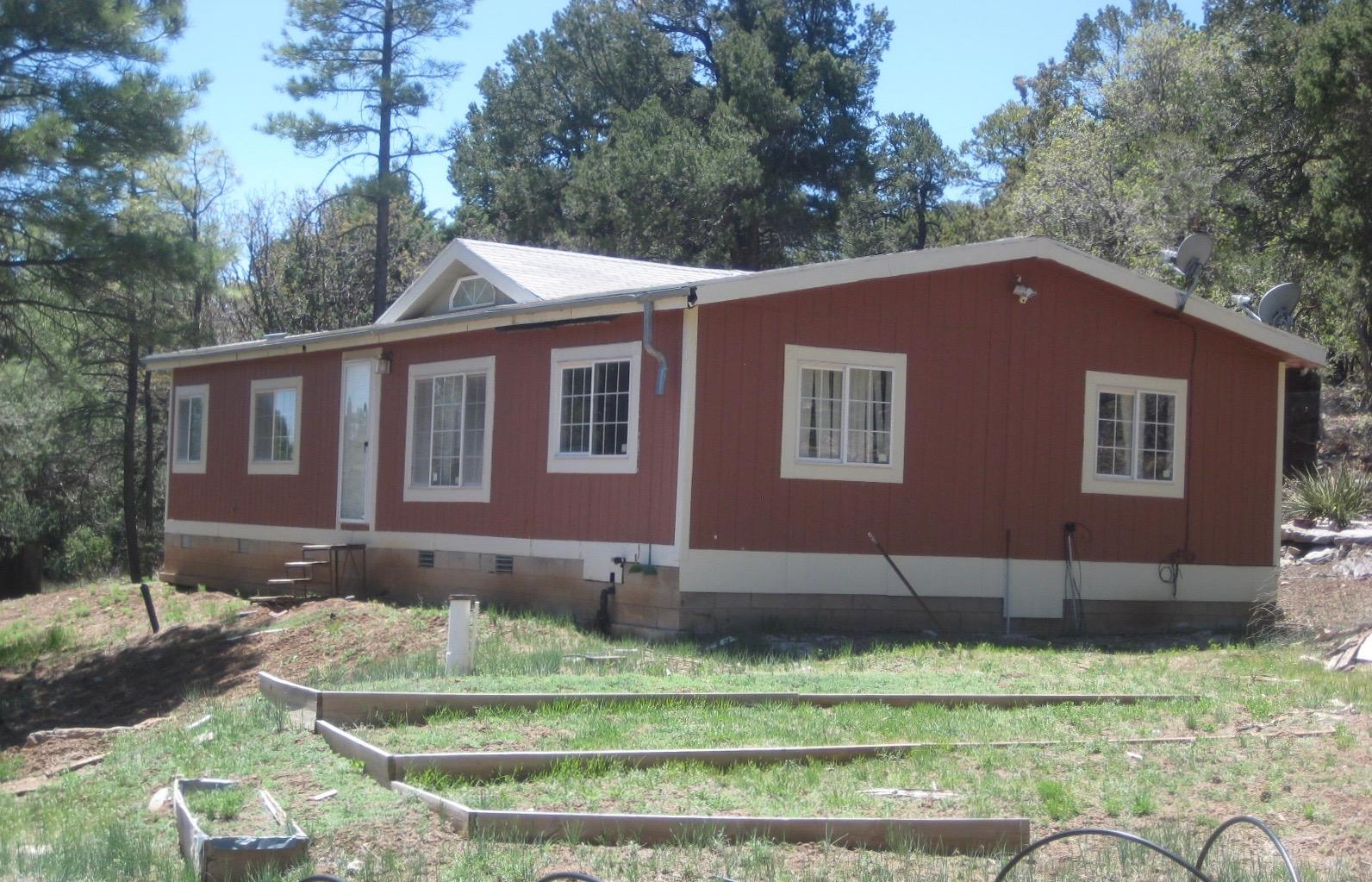 PEACEFUL & SERENE! Your Tijeras Mountain retreat awaits. Sitting high on the lot, this manufactured home features 3 bedrooms and 2 baths. Enjoy relaxing in the large living room or eating in the breakfast nook. The property has a lot to offer! Ideally situated close to shopping, parks, schools and all the amenities of the city, yet the quietly located in the woods. DON'T MISS THIS ONE!!!