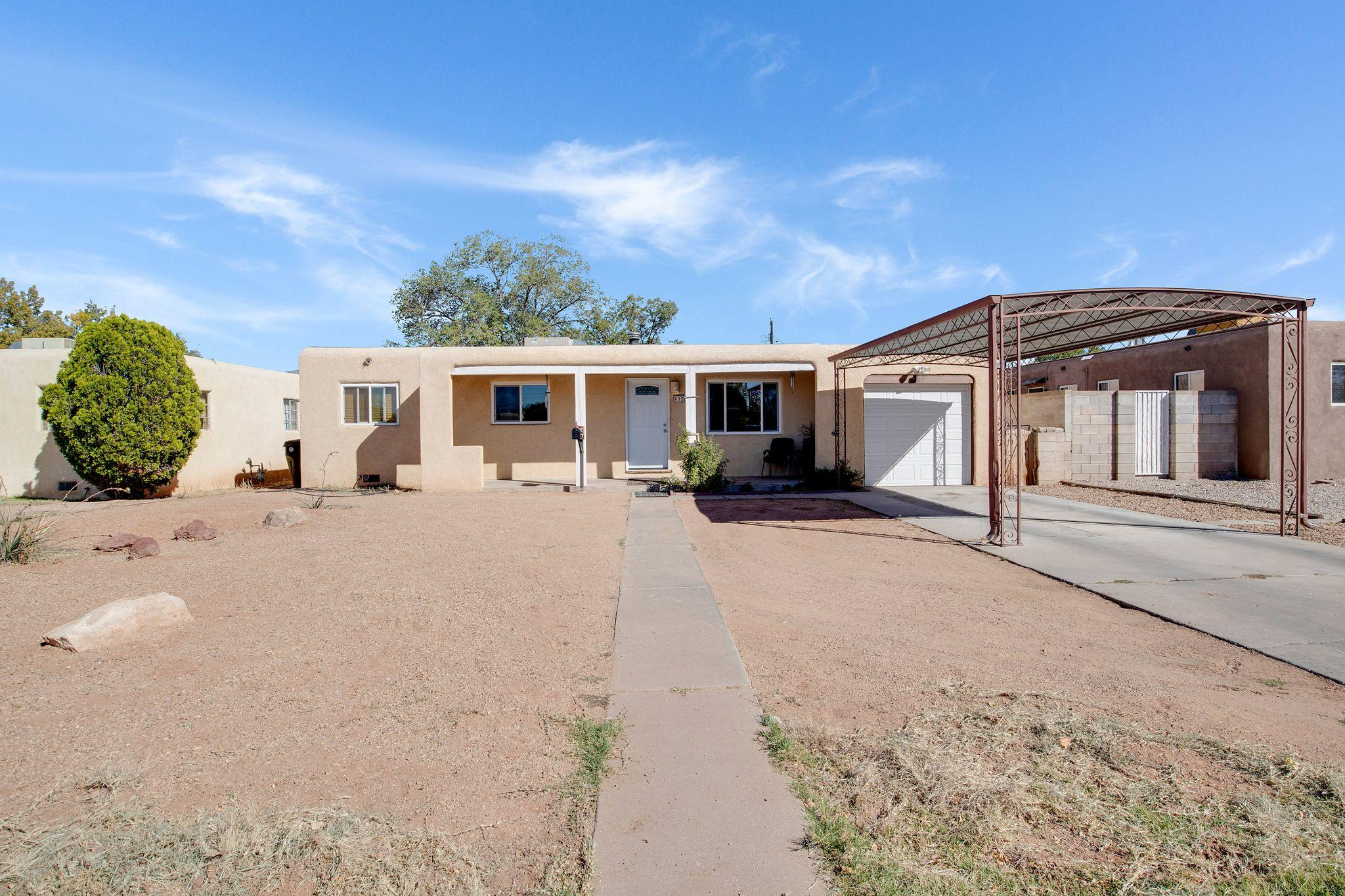 Home SWEET HOME! Updated, Charming, Spacious, open and light-filled! Kitchen has been opened up to the living room and dinning room.  Large living room, 4 bedroom, 2 bath, lovingly maintained. Large private backyard is walled and has endless possibilities, Clean and move-in ready.  Come see!!!