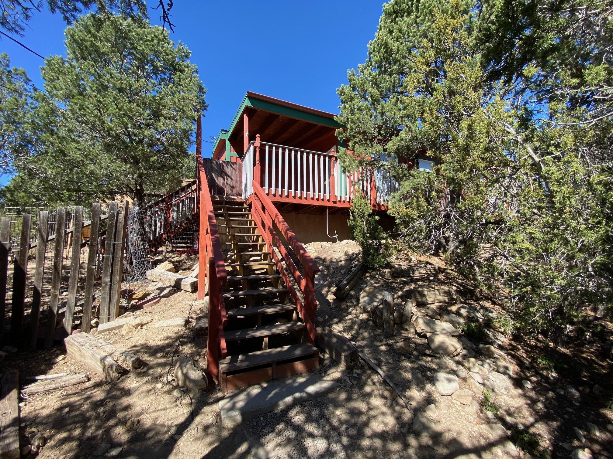 Woodsy and Wow!! Remember that saying?  Enjoy those lovely mountain evenings from the private back deck.  Brand new, never been used stainless appliances, detached 2 car garage, oversized. Light a fire in the woodstove on those cold winter nights. Must See.