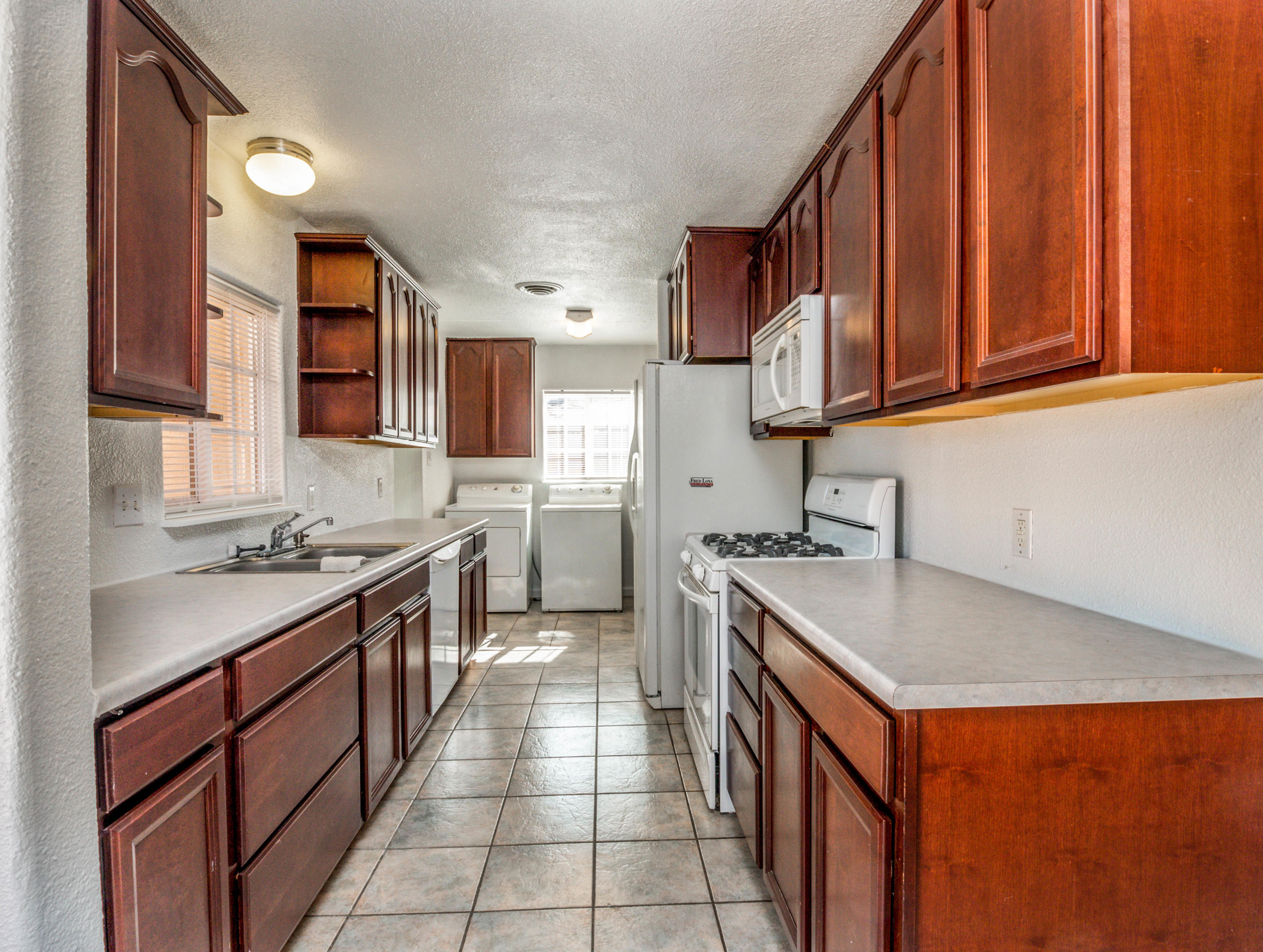 BRAND NEW ROOF, CARPET, PAINT, STUCCO, NEWER VINYL WINDOWS, REFRIGERATED AIR AND HEATING COMBO, HOT WATER HEATER, SEWER LINES, KITCHEN CABINETS ALL IN THE HEART OF ALBUQUERQUE CLOSE TO UNM, CNM, HOSPITALS, KAFB, VA, AIRPORT, FREEWAYS,MALLS, DOWNTOWN ENTERTAINMENT, BEAUTIFUL PARKS FOR WALKING THE DOGS, ALL JUST MINUTES AWAY. Come and see this one before its gone.