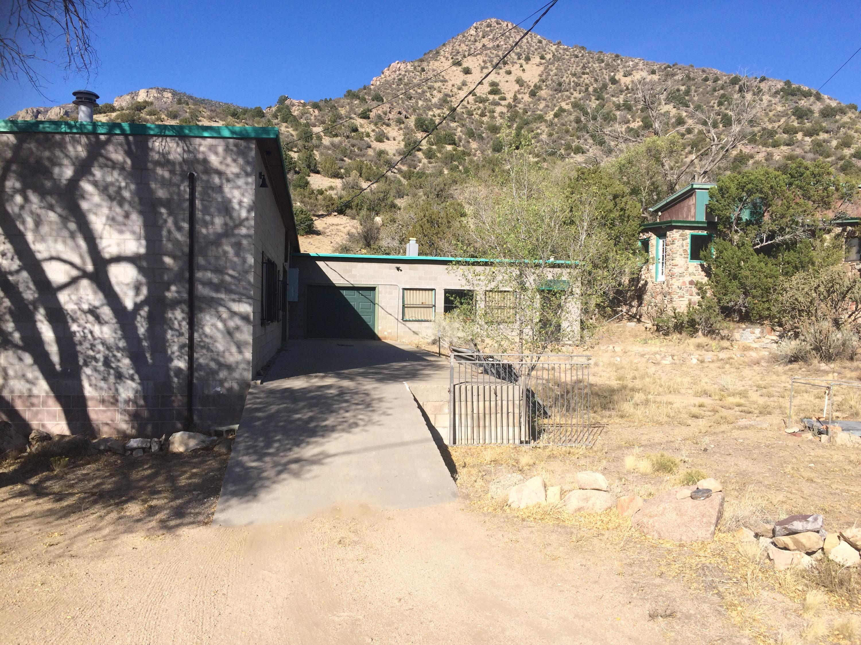 Totally Unique Property!  A 1,900 sq. ft. house with a separate Casita and... a 4,400 sq.ft. warehouse. This property is also listed as commercial. Warehouse subtitle for multi use ie: light manufacturing, auto repair...etc.Views are magnificent and close to ABQ.Potential, potential potential! Call agent for details on this fantastic opportunity.
