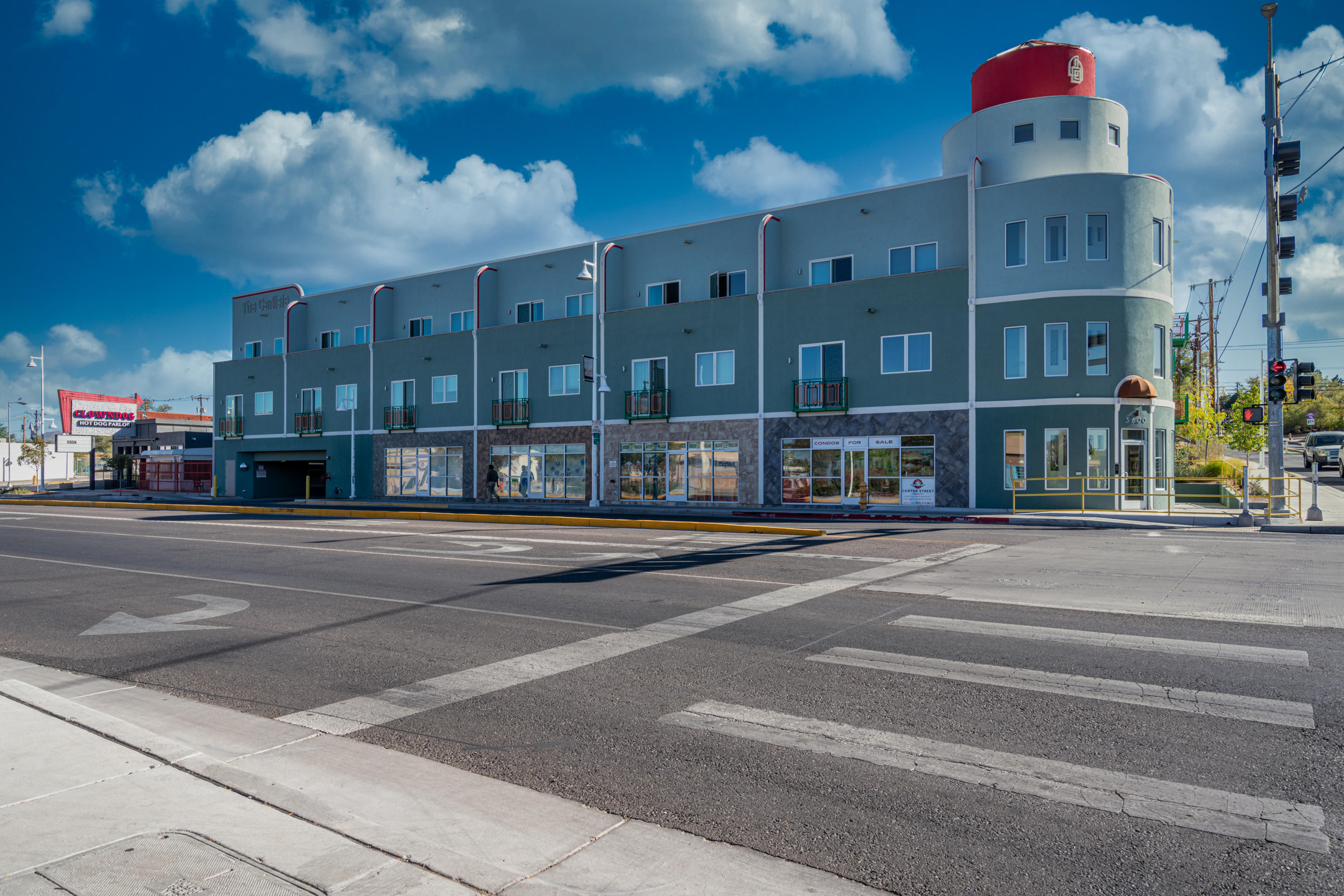 Here is a  beautiful one level condo located on historic Route 66 in the award winning Carlisle Condominiums. Nob Hill just steps away provides you  with  restaurants, breweries, retail shops, and a local co-op grocery store Natural light embraces the modern colors selected for the walls, counters and cabinets  Enjoy ultra efficient LG state of the art HVAC. Quartz counters and Kohler plumbing fixtures. JennAir Designer Series appliances in the kitchen. 2 master suites with large bathrooms and closets.Weather Shield windows and doors, and it's soundproofed with AcousticBlok.   Secure Underground Parking,Full ADA Accessibility. A rooftop terrace provides an  outstanding view of city lights and the  Sandia Mountains. Experience your community in the  Common Area Garden w/ Wat