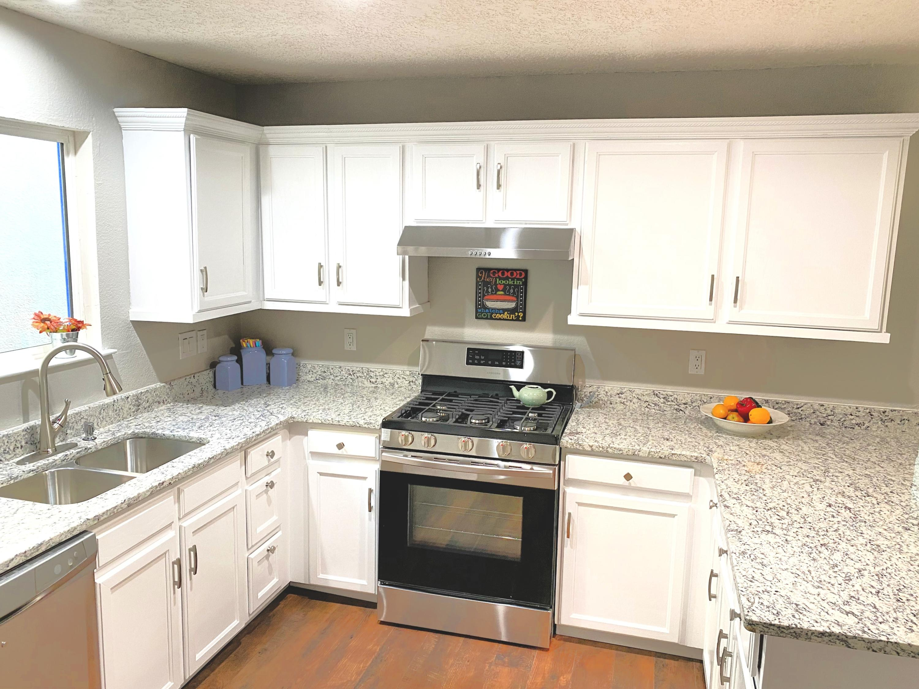 Beautifully remodeled 3 bedrooms, 2 bath townhome located in a convenient location across the street from a park. This home features an open floor plan, new appliances and granite counter tops!