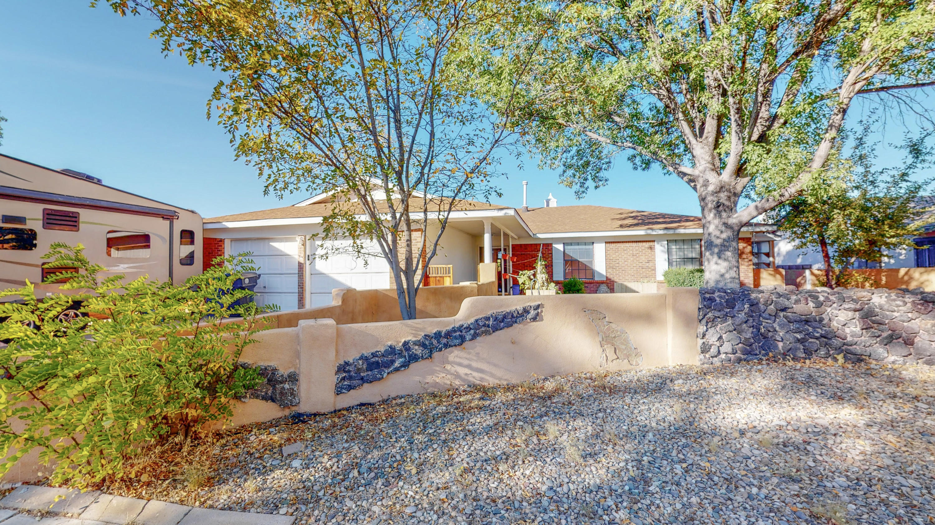 Open House- Saturday 11-1 & Sunday 1-3. This charming 3 bedroom, 2 bath home with plenty of storage is ready for new owners! Tucked away in the desirable Taylor Ranch neighborhood.  This home features a brick exterior and a grass front and backyard with ample room for your garden. Don't forget to relax in the hot tub on chilly New Mexico nights! Enjoy meals in the cozy breakfast nook. Further updates include a new furnace and refrigerated air unit as well as a new water heater. Roof is only 7 years old! Close by grocery stores, shopping, and restaurants. Schedule your showing today!