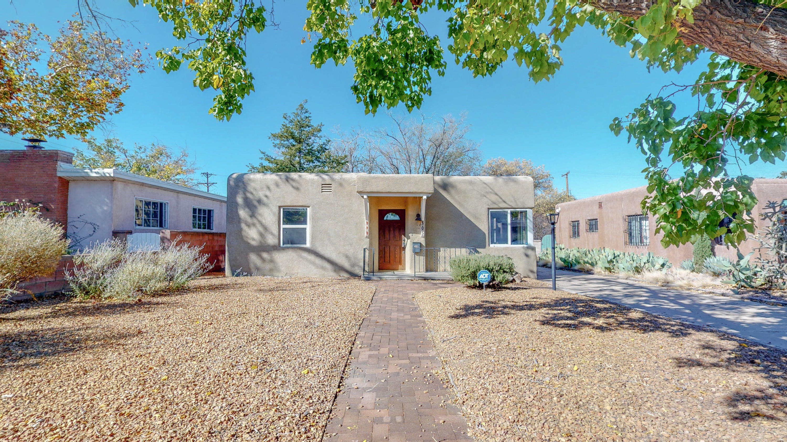 Move-In Ready! This sweet 2 bd, 1 bath home in the UNM area boasts wood floors and updates throughout. Kitchen has  new counter tops, kitchen cabinets and appliances. Tankless water heater will save you money! Plenty of room in the detached garage and large backyard. Newer windows and stucco.