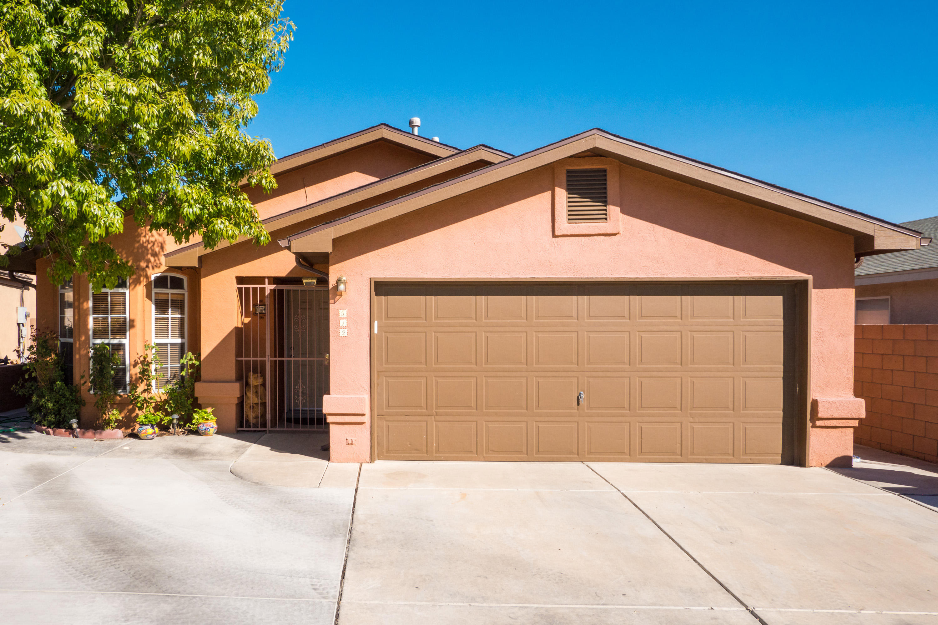 Beautiful home near shopping centers. Walk into this home and enjoy an open floor plan with tile throughout. This homes comes with a newer roof, refrigerated air, and remodeled bathrooms. Enjoy a private oasis feeling in lovely the back yard.