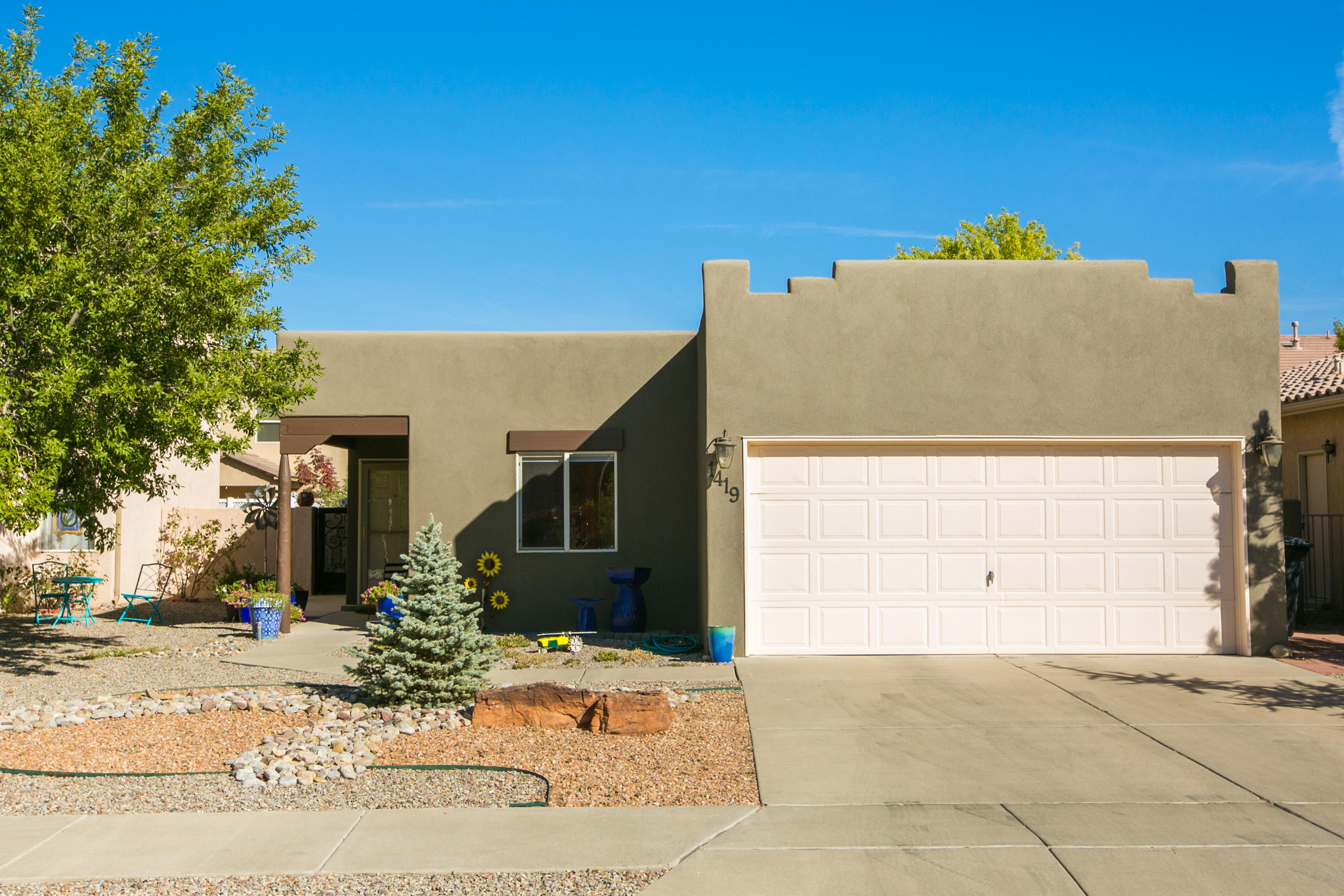 A Gorgeous updated 1-story home with REFRIGERATED Air in a beautiful community...with Rio Rancho Prices close to I-25 & Paseo Del Norte!  This home was updated with Luxury vinyl plank, new carpet (2018), water heater (2019) and a new roof and stucco in 2016! It also features double pane vinyl windows & eco-friendly landscaping with a drip system in front!Gorgeous open floor plan with all new fixtures  - Make your appointment today! This home will go fast!