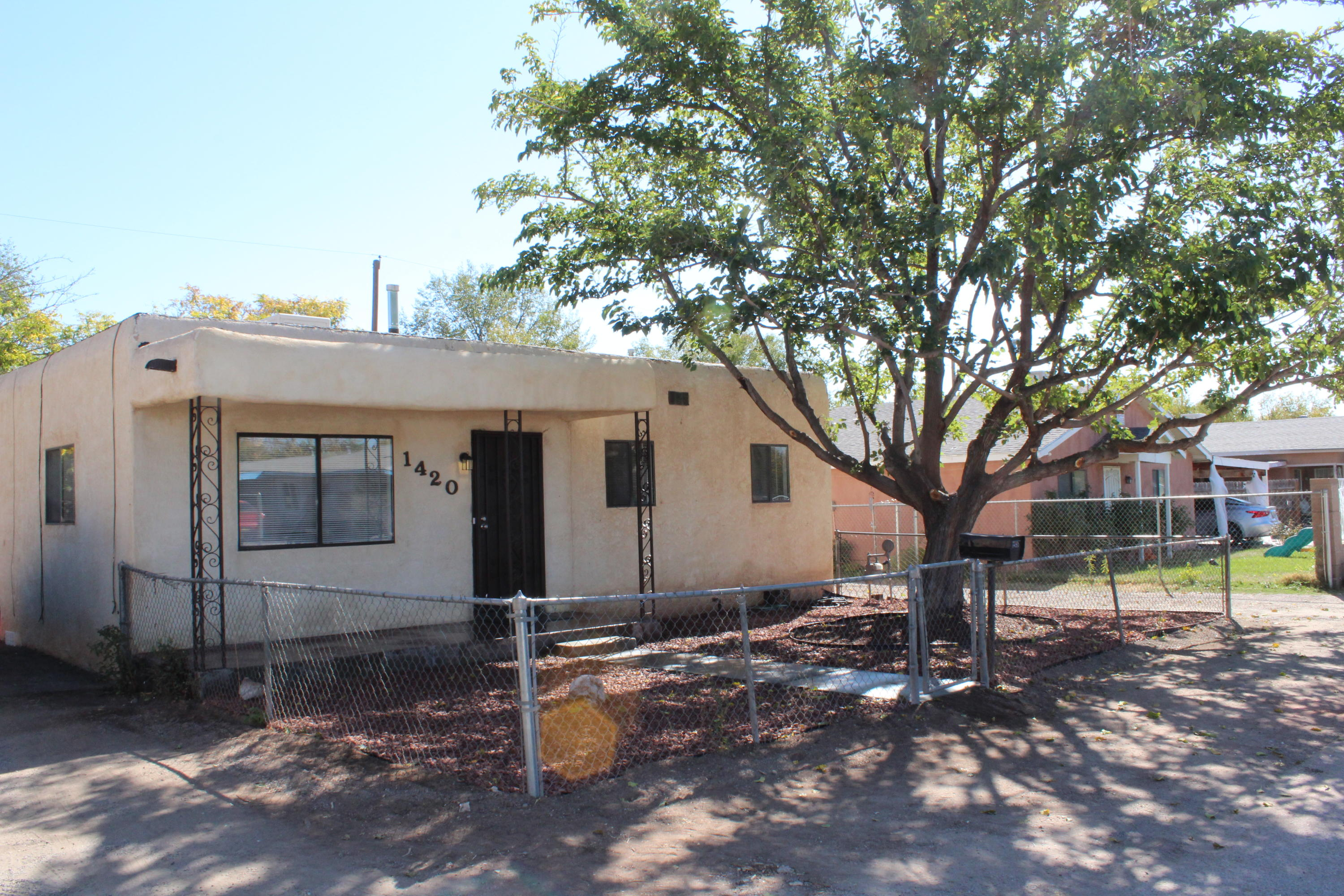 This adorable home is tucked away in the south valley in a well established neighborhood.Features all new flooring, new countertops, bathrooms have been renovated, fresh paint and new blinds throughout, all new ceiling fans and lighting.All appliances included, gas stove features five burners and self-cleaning oven, and refrigerator haswater and ice maker, washer and dryer are as is (are in working condition), new front yard landscaping.This home has vehicle access to a  large enclosed  back yard  for gatherings and plenty of room for kids to play.It is conveniently located to shopping,  local eateries, church, community center and bus stop.Sewer line and Termite Inspection have been performed, all is good!!Come and  show this home!  You won't be disappointed.Thank you fo