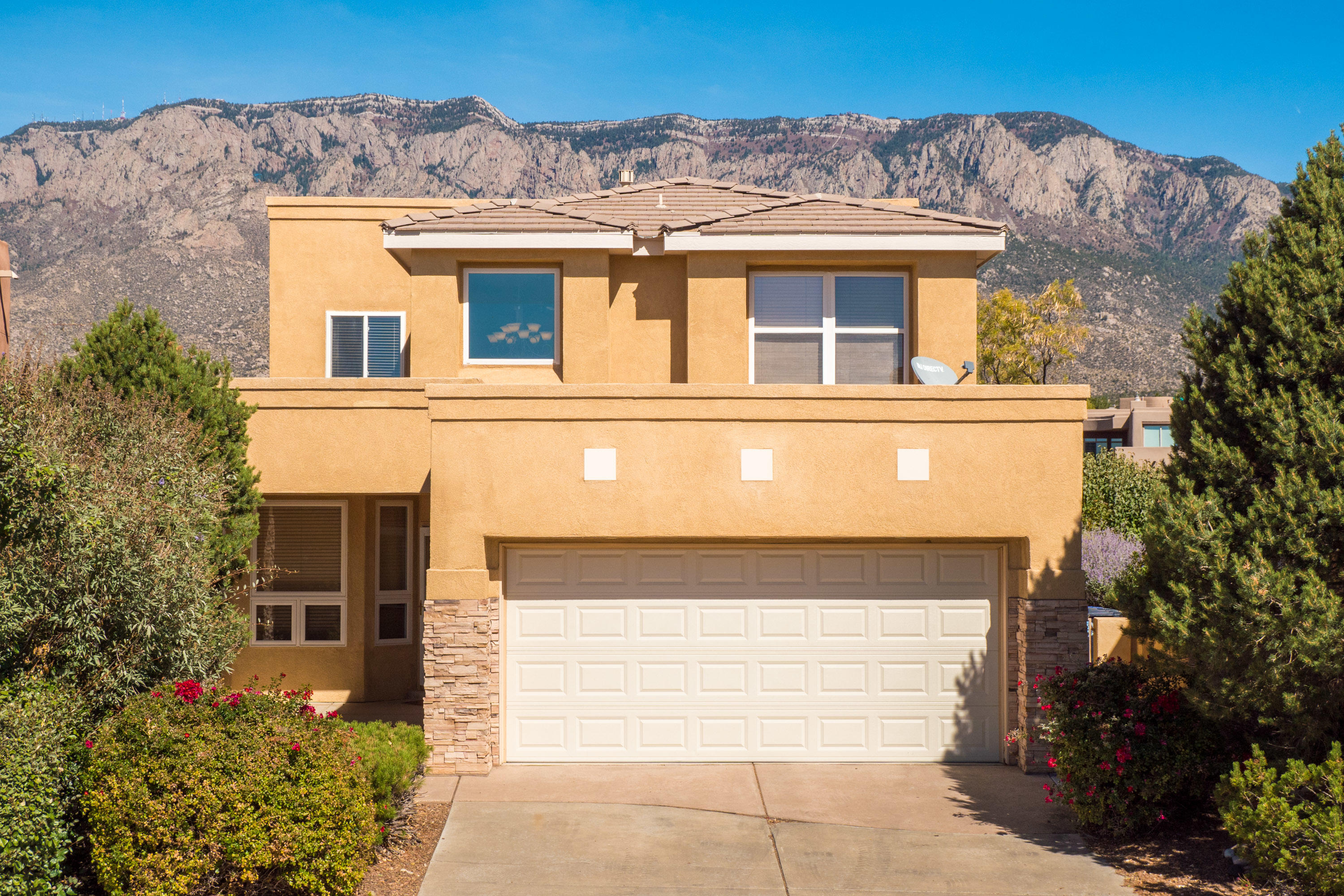 Open House Saturday 10/24 12-2pm. Welcome Home to this bright and open Desert Mountain  home. Picture perfect views of the Sandias, open concept floor plan with master bedroom on the main level. Two additonal bedrooms upstairs, with a loft/office space. The home is in an ideal location, right across from the community pool. This was the prime lot in the neighborhood when the developer started building. 2 car garage, easy maintenance yard, with a beautiful rock fountain, and patios ideal for entertaining. Walking trails, and parks nearby. Hurry this home wont last!
