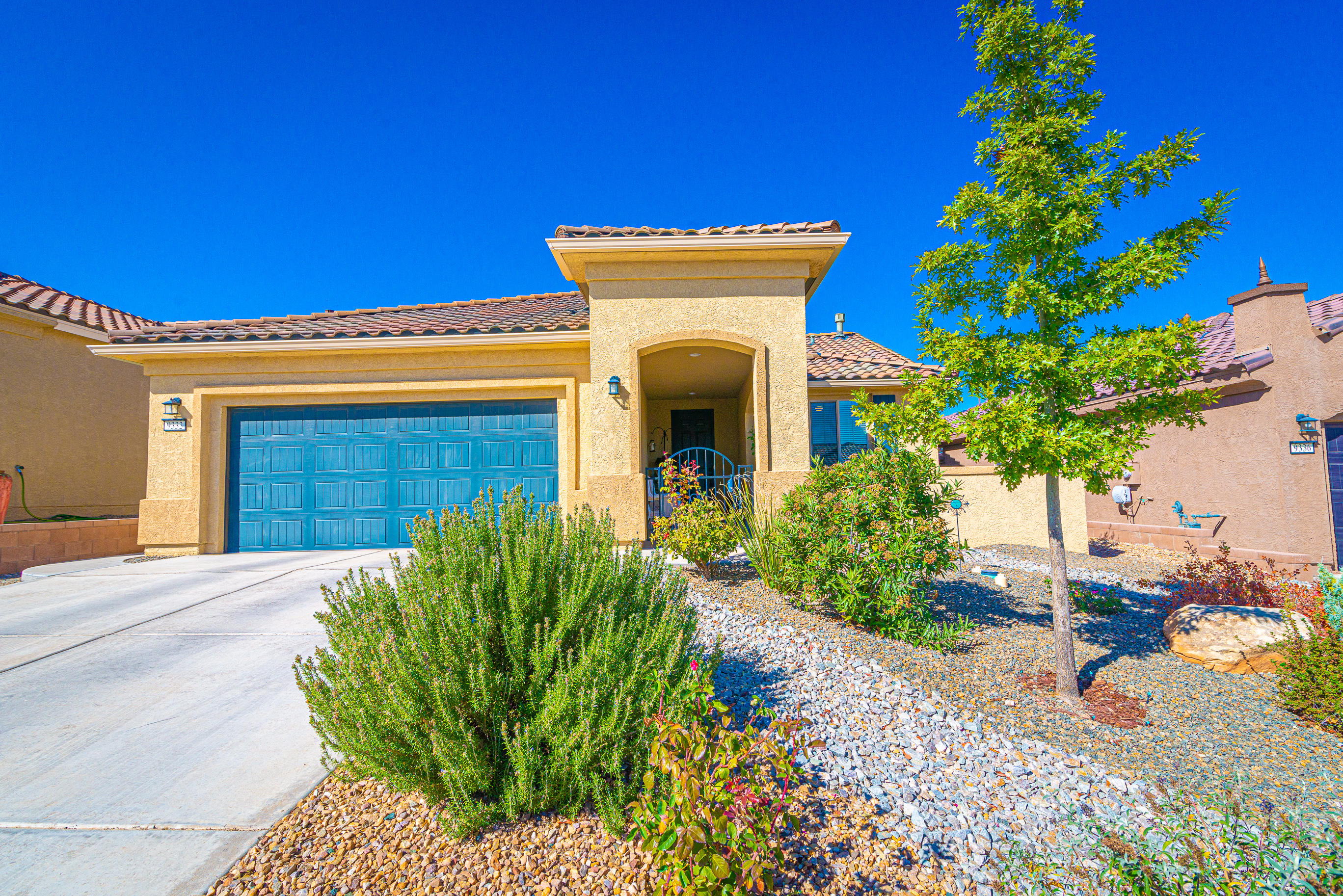 Gorgeous Light and Bright Home located in the Del Webb 55+ Community! This 'Sanctuary' model has approximately 1835 SF, 2 BR's, 2 BA's, an Office/Den or 3rd BR, Roomy 2 CG with a 4 foot extension, raised walls in the backyard for privacy plus a view of the Petroglyphs!  The kitchen has beautiful cabinetry, granite countertops,backsplash, raised dishwasher, gas cooktop, kitchen island, pull-outs, gas cooktop & pantry! Master bedroom has upgraded bay windows, coffered ceiling, large WIC, Dbl sinks, linen closet & walk-in shower! Laundry room has additional cabinets!  All Appliances Stay! Backyard was professionally landscaped with turf, arbor, stone walkway, raised garden, fountain, etc.  BBQ grill is staying and is hooked to the gas stub-out. Clubhouse offers daily activities, pool, etc