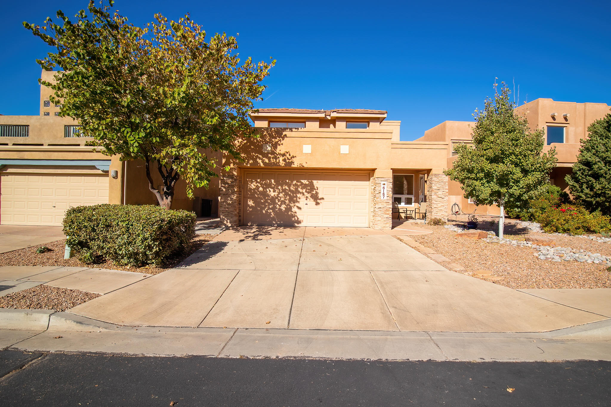 Beautiful SW style home in the gated community of Desert Mountain in High Desert. This home boasts a large wall of windows with great natural light, open floor plan, and plenty of living space. Kitchen offers lots of prep & cabinet space, 2 year old stainless steel appliances and a breakfast nook. Gas fireplace & built in shelves add character to the living room. Owner's suite is on the main floor with a full bath and private access to the backyard.  Upstairs are two bedrooms and a large loft, which could be a game room, office space, etc. Magnificent mountain views from the upstairs view deck and also from the front of the home.  Blinds (living room) & decking put in 2018. Quick and easy access to many hiking and biking trails.