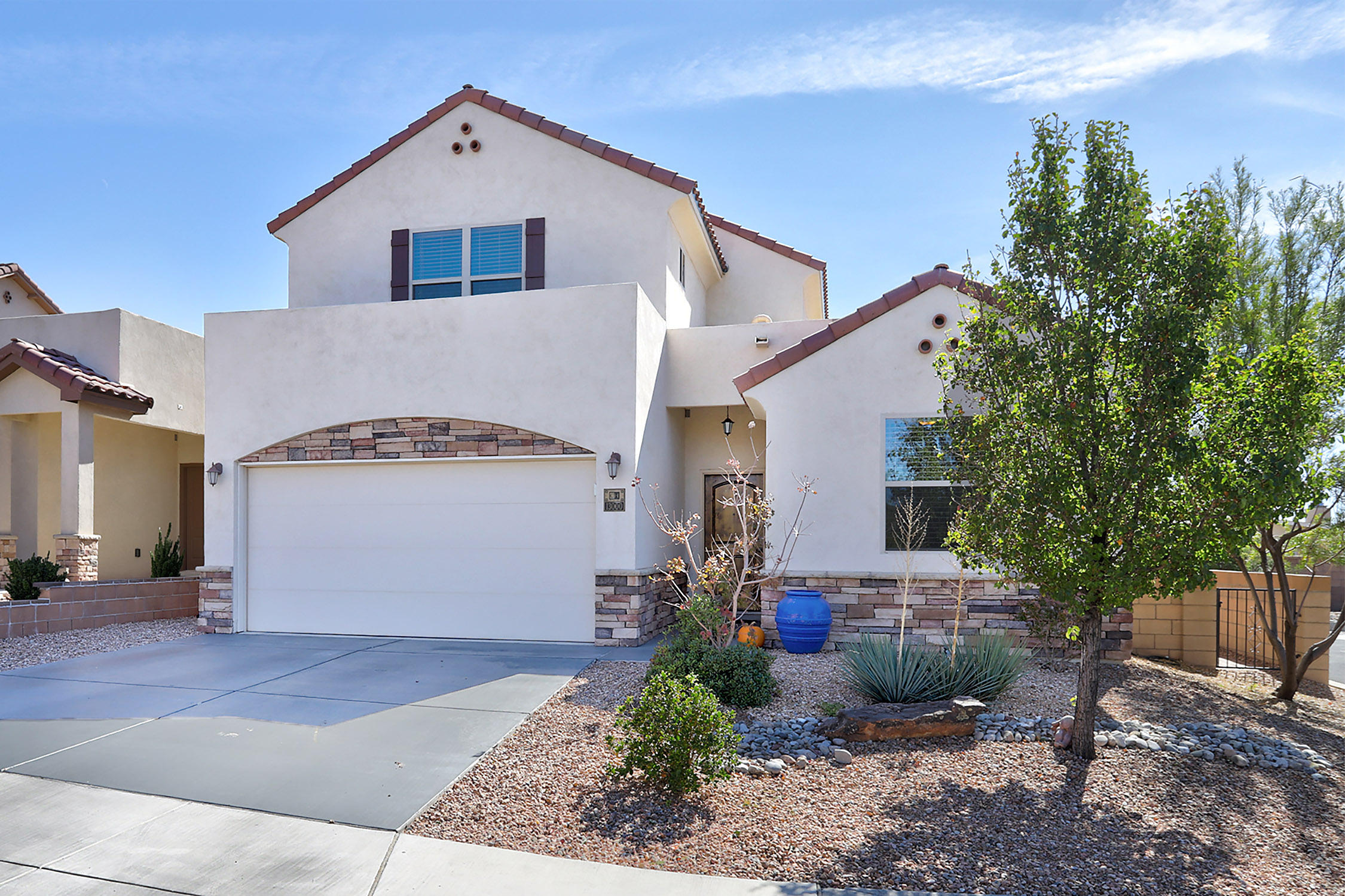 In a Gated Community Nestled in the NE Heights near the foothills! OPEN HOUSE ON SATURDAY 10/24 - 1-4pm.   Only minutes from I-40 and Sandia Labs, you will find this Amazing Dream Home! Beautiful engineered wood in the entry way, formal dining area and great room, 18 inch tile in the kitchen, laundry room and all wet areas. The Cook's kitchen has Alder cabinetry with granite counters, tile back-splash, butler's pantry + more! Downstairs is a full bedroom/study/guest suite with an adjacent full bath. Upstairs is a fabulous reading loft with a built-in bookshelf and amazing sunset views. Master Suite with custom walk-in wraparound master shower with three shower heads including rain head, walk-in closet, and view balcony.  COME SEE THIS BEAUTY!
