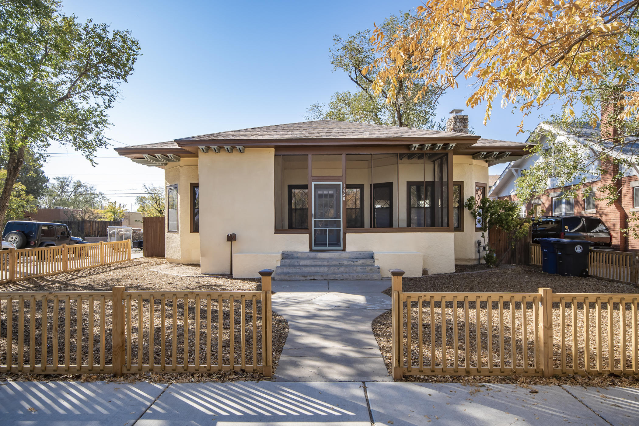 You won't find a better walking score in the city!  Steps to UNM, 3 hospitals, restaurants and ART++.  This plaqued home is on Silver SE; aka, Bicycle Boulevard, the city's only dedicated bicycle roadway with bike access to Nob Hill/Downtown.  This 1920's Sears, Roebuck Cottage ''kit-home'' has been restored and updated. The 3 BR, 3 BA home boasts: NEW kitchen, master bathroom, flooring, roof, storm windows, heating, refrigerated air, electrical service, plumbing, lighting, ++.   Original ten foot ceilings, rolled glass windows (15) and river stone fireplace anchor the great room. Bright, large lower level with 3/4 bath.  New back patio, xeriscaping, fully fenced yard with 2 car garage!