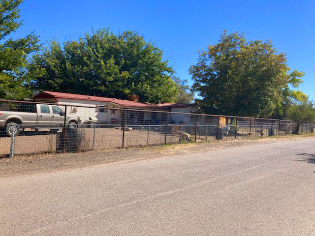 Great opportunity awaits on this 1/2 acre property in beautiful Bosque Farms! 1,272 sq ft, 3 bedrooms, 1 bath with 2 living areas, country kitchen, wood-burning fireplace.  1-car garage.  Shop building has 220 electric.  Fenced & zoned for horses.  2 wells plus City water and City sewer.  Minutes to Albuquerque & Abq Airport.  Close to all City conveniences.