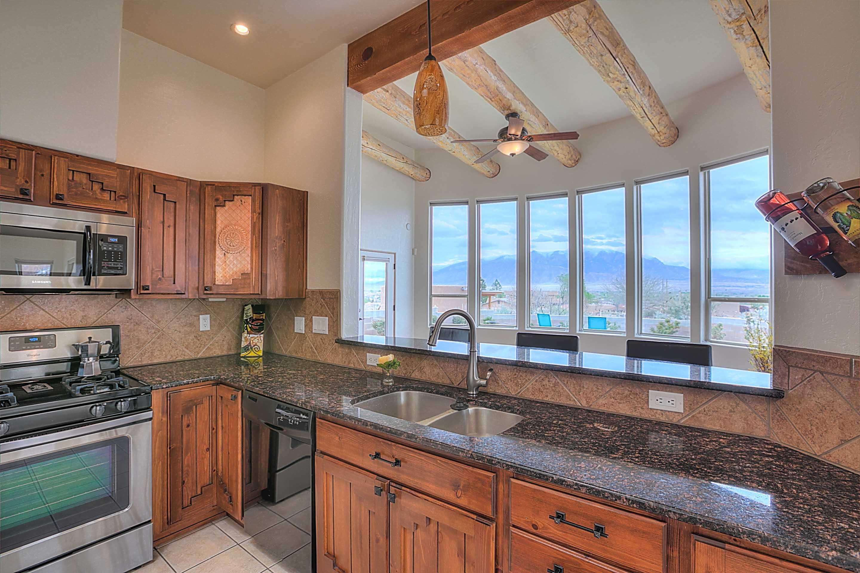 AWARD WINNING Custom home! Situated on over an acre!*ELEVATED MILLION DOLLAR VIEWS*PRIVACY* Large island kitchen with upgraded stainless appliances and gleaming granite counters. Custom cabinets w/copper inserts, overlooking the great room featuring: a sweeping wall of curved windows, scraped wood floor, raised ceiling, suspended shaved vigas & hand plastered fireplace. The master retreat has a hand carved beamed ceiling & private view patio. *REJUVENATE in the SPA Inspired spacious master bath featuring custom tile, a dual headed shower and large tub. HUGE walk-in closet. Newer refrigerated air and furnace. Fully landscaped with grass, trees, roses & wisteria. MANY CUSTOM EXTRAS! Circular entry skylight, intricate entry medallion, stacked stone accents. *PRIVATE PAVED ROAD* *A WOW HOUSE*