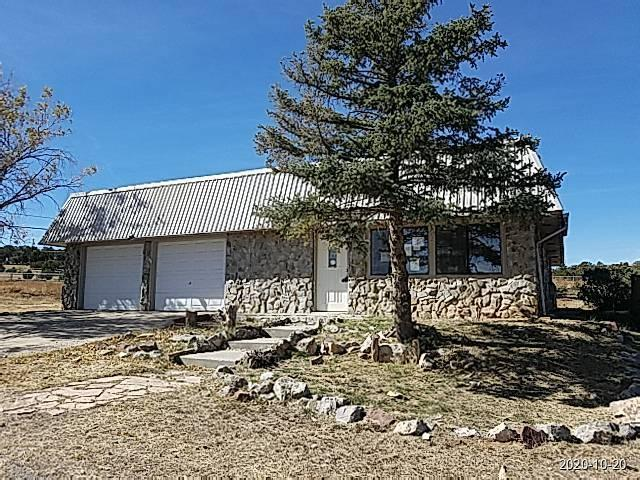 Just half an hour east of Albuquerque sits this unique 3 bed, 2 bath home with 2-car garage.  You can see the vision someone started, and now you can finish it, or create one of your own.  Stone exterior, and stone accents throughout home.  Kitchen has island, lots of counterspace and cabinets.  Gorgeous stone WBFP in LR.  Master suite has spacious bedroom and cedar closet, double vanity and garden tub with stone surround and skylight.  Lots of storage and shelving in garage, and big workshop/storage building in back.  Large, fenced 1 acre lot.  Great location - country living, yet close to the big city.