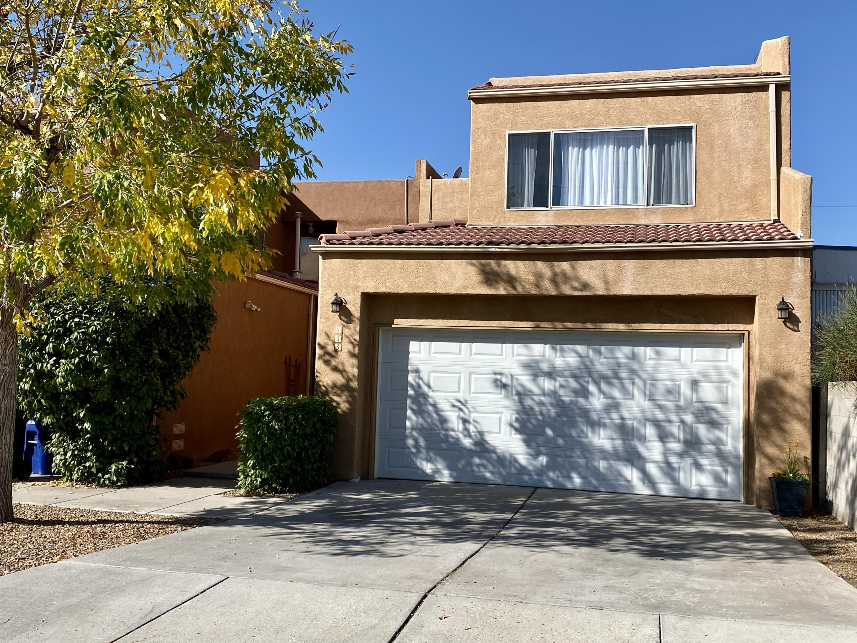 Centrally located 3 Bedroom/3 Bath end unit townhome with 2 car garage & no HOA FEES! 1825 sqft. with room for all your living needs. Well maintained with a New Roof installed in 2019, New Heating/Cooling HVAC system installed summer 2020.  Kitchen with breakfast area & walk-in pantry, stainless steel appliances, cathedral ceiling w/3 skylights to bring in lots of natural light. Gas fireplace, large master bedroom w/walk in closet. Laundry room w/washer and dryer and lots of storage, low maintenance back yard, private gated entry courtyard. Seller to include a home warranty.  Owner is non-smoker and has had no pets during ownership. Close to Nob Hill, CNM, UNM, Sandia Labs, and Kirtland AFB, Marion L. Fox Park & many shopping conveniences.