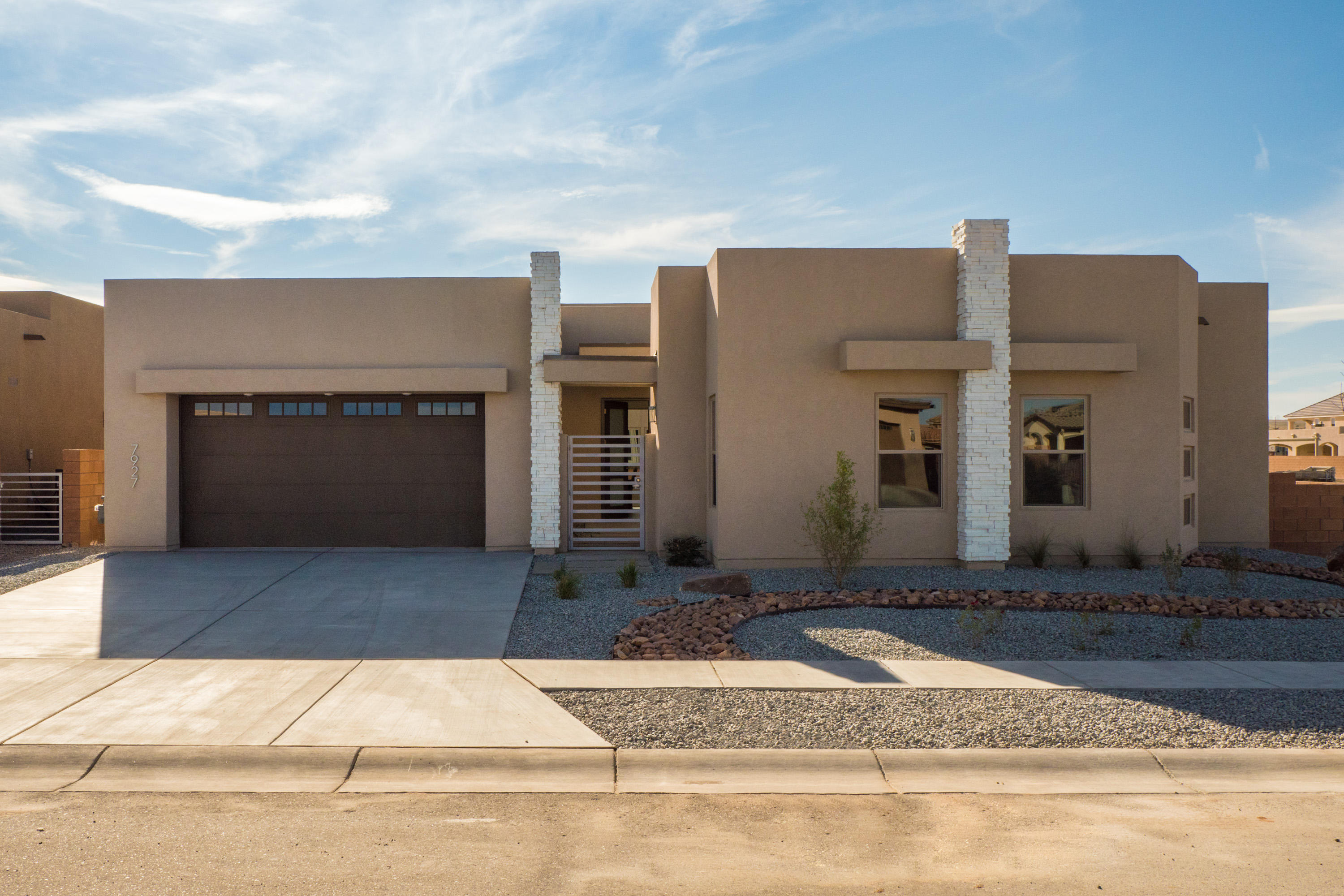 Brand new one-of-a-kind  Rhett Ashley beauty with a new floor plan in the Petroglyphs community! Home features 1,821sf with 3 bedrooms and 3 bathrooms. Gated courtyard entrance! Gorgeous kitchen with upgraded cabinetry, quartz countertops, custom backsplash, gas range, range hood, built-in microwave, dishwasher and refrigerator, large island with seating area and a pantry. Beautiful open living area with large picture windows and outdoor access. Elegant owners suite with outdoor access and a barn door that leads to the spa like bath. Bath hosts dual sinks with granite countertops, a relaxing freestanding tubs, walk-in shower with tile surround and a walk-in closet! Great backyard fully walled with a large covered patio.