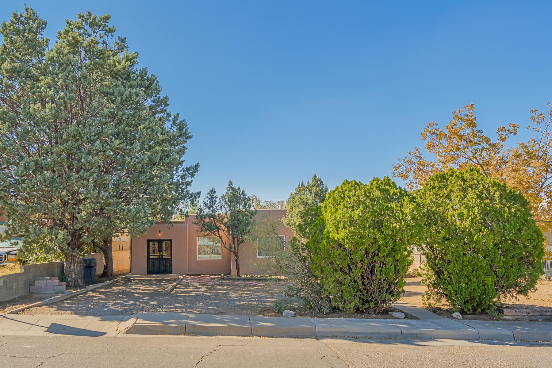 Super close to Hyder Park and Nob Hill, UNM, the hospitals and KAFB.  New roof, new windows and new stucco and the lot was cleared of very aged trees and overgrowth.  Saavy investor, starting out or starting over???  Ready for your design for gardening or outside retreat.  Inside was freshly painted.Please allow 48 hours for response to offer.  Sellers prefer Lori Holland at FNT.  Attach letter of pre-qualification to offer.