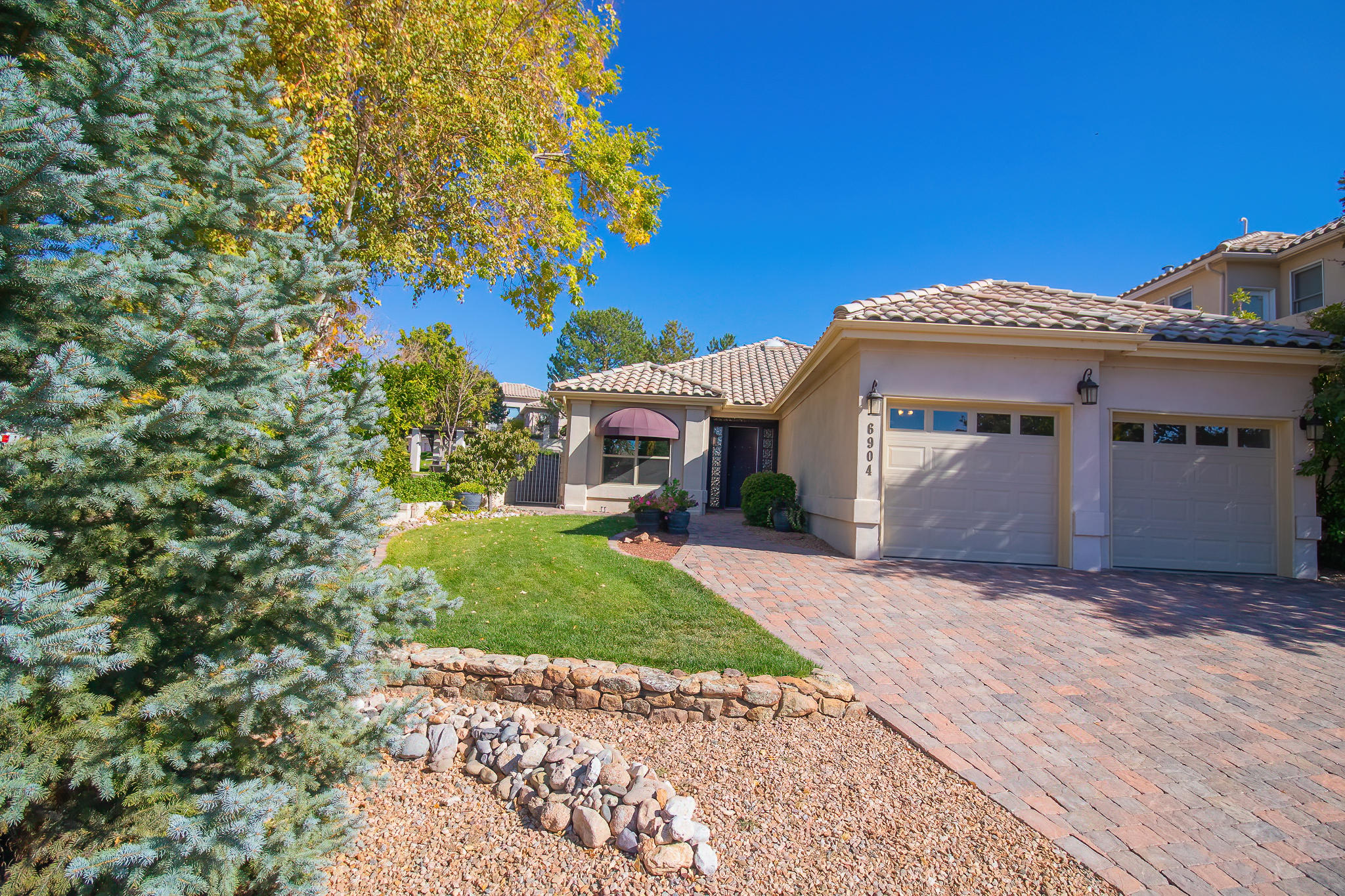 Fabulous single story in sought after gated community The Enclave at Tanoan. This home offers exceptional curb appeal. Living room with a fireplace opens up to the Kitchen & Dining Room and has Mountain Views! The Kitchen with granite counter tops and updated cabinets is just perfect for prepping & storing. Spacious Owner's Suite has a spa like bath with a jetted tub, separate shower & double sinks.  One of the secondary bedrooms has a Murphy bed! Very peaceful backyard with lush grass and Mountain Views. Greenbelt behind home for privacy. *** Please allow a 48h min. response time on any and all offers.