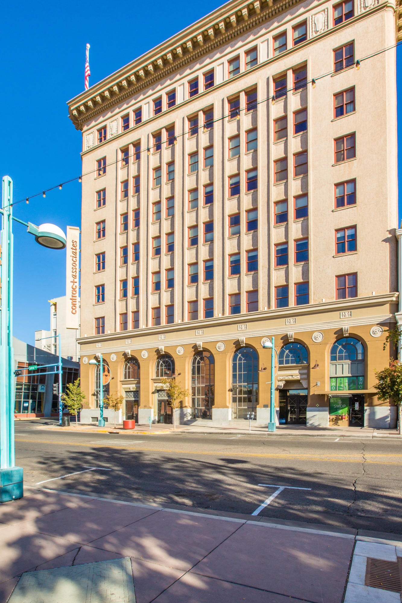 Located in the Heart of Downtown ABQ in a secure, key card access old Sunrise Bank Building.  This 2 level unit is beautifully appointed with modern fixtures, lighting and materials.  The kitchen features stainless steel appliances and custom cabinetry.   A half bath is located on the first floor.  Follow the steel and wood staircase to the 2nd floor where you'll find a master bedroom suite with a private patio, walk-in closet and spa style bath.  The  large guestroom has beautiful south facing views.  Access to the 8,000+sqft rooftop deck with expansive panoramic views of the city and mountains!  5th floor garage access parking is optional.