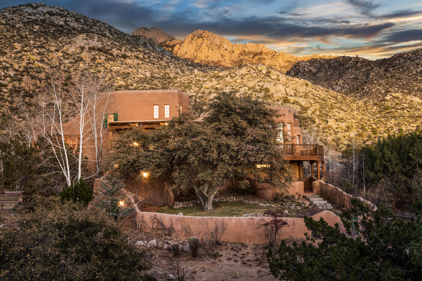 Absolutely stunning George Lewton custom adobe on a serene and secluded lot, backing up to the National Forest in Sandia Heights North! This awe-inspiring property has City & Mountain Views from almost every room, several fireplaces (including one in kitchen), high ceilings, an abundance of light, and patios and decks to capture the Views, along with the quiet and solitude that this sanctuary offers. Flagstone, saltillo, brick and wood floors, kiva fireplaces, vigas, latillas, and all the charm you'd find in Santa Fe! 378sqft workshop, 104sqft craft space & 182sqft wine cellar not included in square footage. *** Please allow a 48h min. response time on any and all offers.