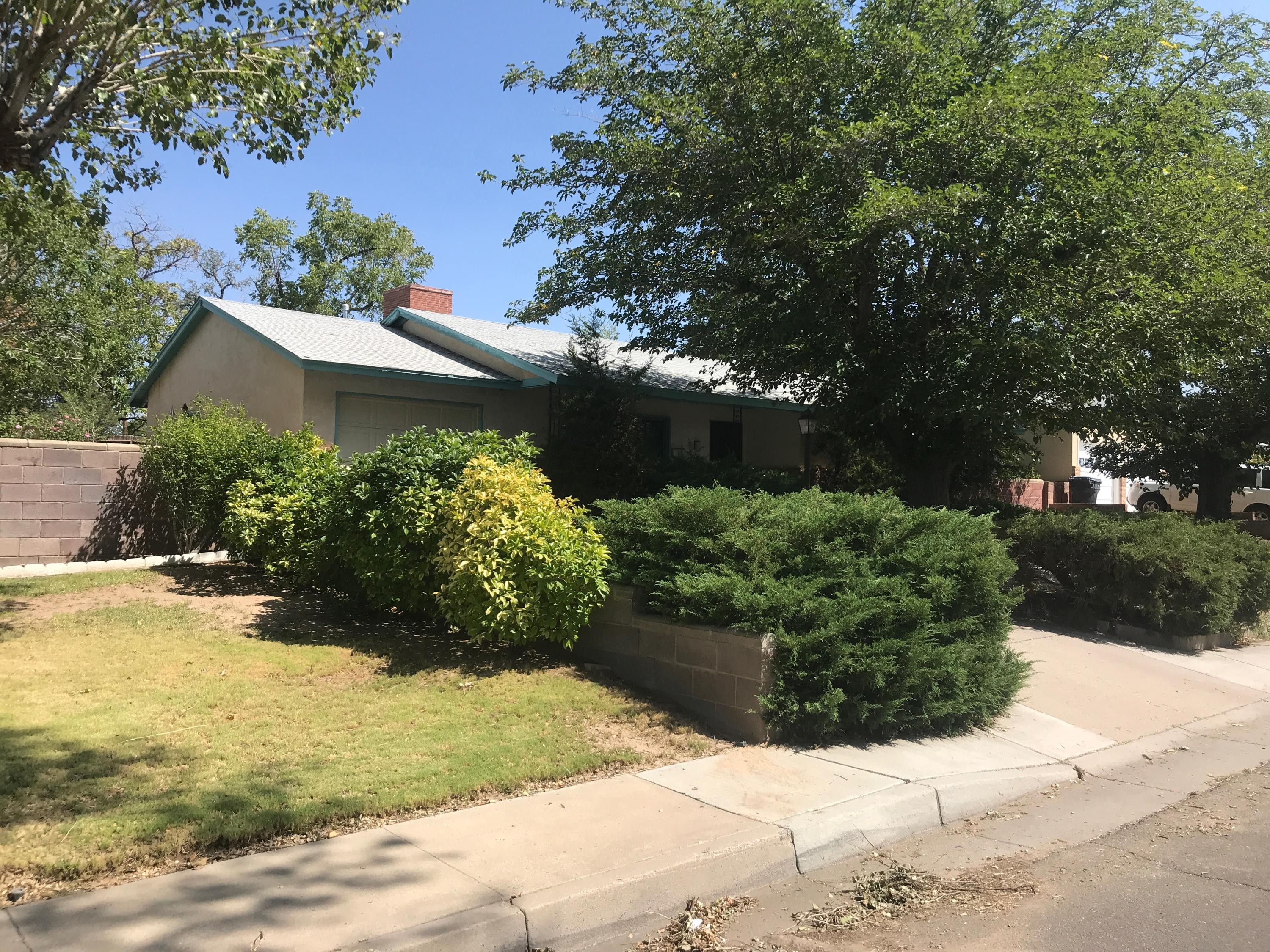 Great location--right across from a beautiful  park.  Three bedrooms and a bath and three quarters provides space to accommodate families, roommates, or office space for working at home.  Large living room with a wood burning fireplace merges into spacious dining area.  An enclosed laundry room has been in the garage, leaving plenty of area to park.  the kitchen has generous storage.  outside in front are two large shade trees a covered entry porch.  The backyard is very large with mountain views and ready for your imagination.  All this, plus refrigerated air for hot summer days.  In addition, the roof was replaced within the last month.