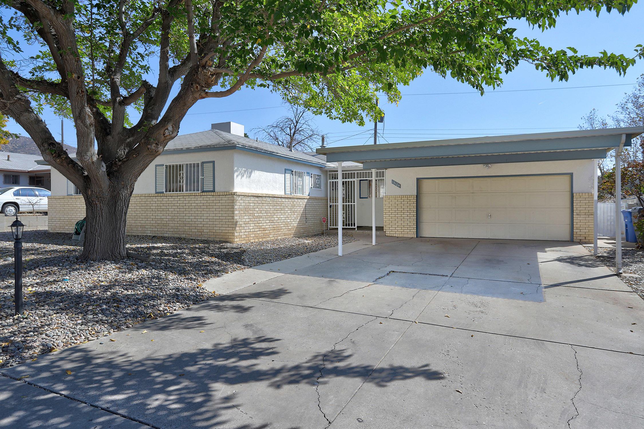 Clean & move in ready in the NE Heights. Two spacious living rooms, one with a fireplace is perfect to close off from the rest of the house. Kitchen has granite countertops, lots of storage, and eat at bar.  Both bathrooms have been updated with marble top vanities & custom tile work. Oversized laundry room perfect for craft room or office. Private back yard is ready for your garden. 2 car carport to keep the snow off your vehicles. 5 year old furnace & master cool duct through the house, with a second cooler for the den. New shingle roof being installed. Easy access to I-40.