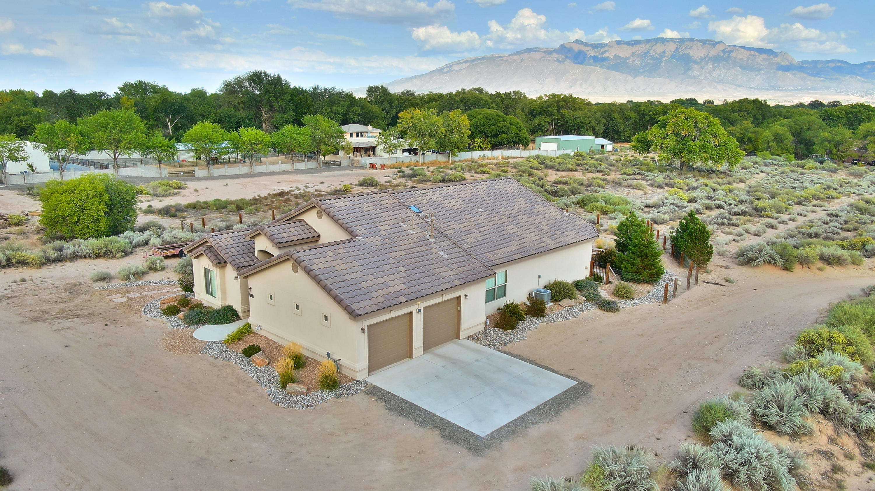 Rare Corrales property on over 2 acres with amazing mountain views! Originally designed to be a horse property, this location now has the potential to be anything you want. The likenew home was built in 2017 by Summertree Homes. Modern amenities include the open floorplan with raised ceilings and lots of natural light, tile floors throughout, elegant white kitchen with high end appliances, water softener, ref. A/C and so much more. The home is set up for future solar power if owner desires. This functional floorplan leaves no wasted space. The outdoor living possibilities are endless beginning with gas fire pit. If you are looking for the charm and views Corrales has to offer, with a low maintenance newer home, look no further.