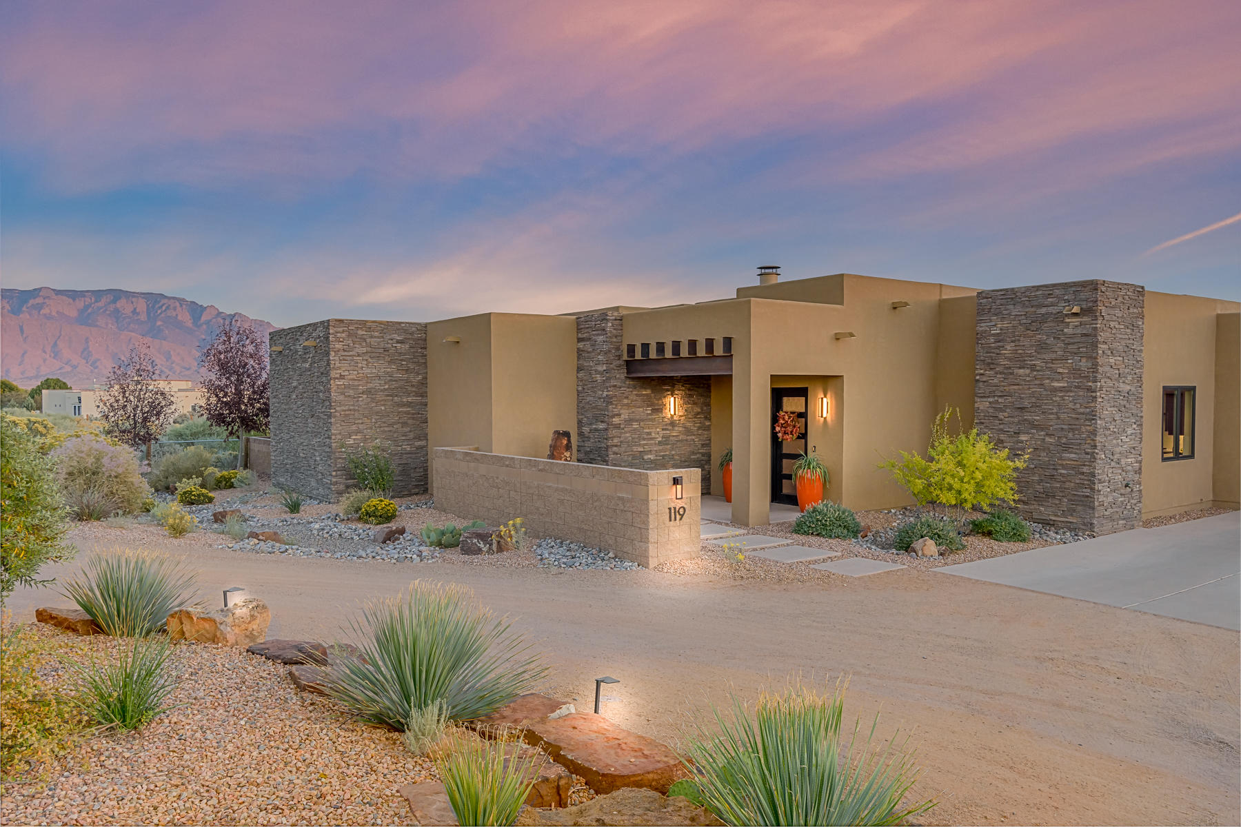 Amazing multi-generational estate with unobstructed views of the mountains and city lights! Rare opportunity to purchase the builder's personal home with a detached guest house.  This is an award winning home that swept all categories in the 2017 Parade of Homes. Old meets new in a thoroughly modern take on classic southwestern style.  The home blends traditional pueblo architecture with brick, steel and glass to define a completely new genre. Features of the main house include 3 bedrooms plus a bonus room, 2 3/4 bathrooms, brick floors, a unique masonry fireplace with a floating concrete hearth, floor-to-ceiling windows, small pool/hot tub.  The guest house features 1096 SF with one bedroom and open concept living, covered patio with views and a private driveway/entrance off of El Dorado.
