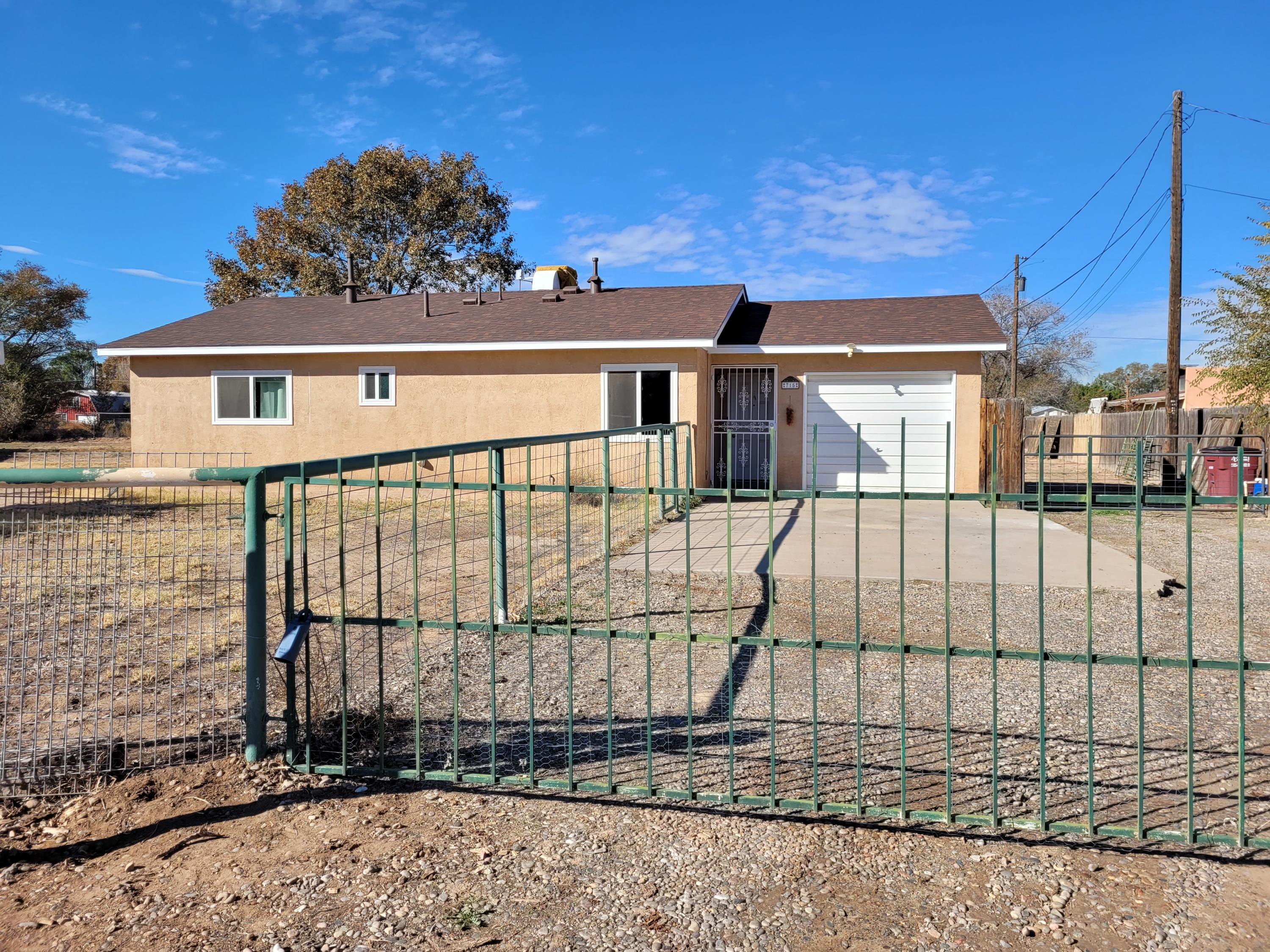 Ranch-style 3 bedroom, 1.5 bath w/ single car garage in beautiful Bosque Farms on over a half acre of land. All appliances stay! Great place to start or if downsizing, this home is situated in the quiet Foxcroft Acres area and backs up to the Otero Drain with easy access to walking, biking, and riding. Just a nice walk from the Rodeo Arena, community center, playground, and youth sports fields! This home is site-built and well insulated with all energy efficient windows, a BRAND NEW roof and all tile or LVT flooring, tile surrounds. Home is on Village of Bosque Farms water and sewer-no septic! Property is fully cleared, fenced w/irrigation well for all of your gardening, landscaping, and animals. Plenty of space for horses,  shop, & more. Minutes from Albuquerque, take the drive & enjoy.
