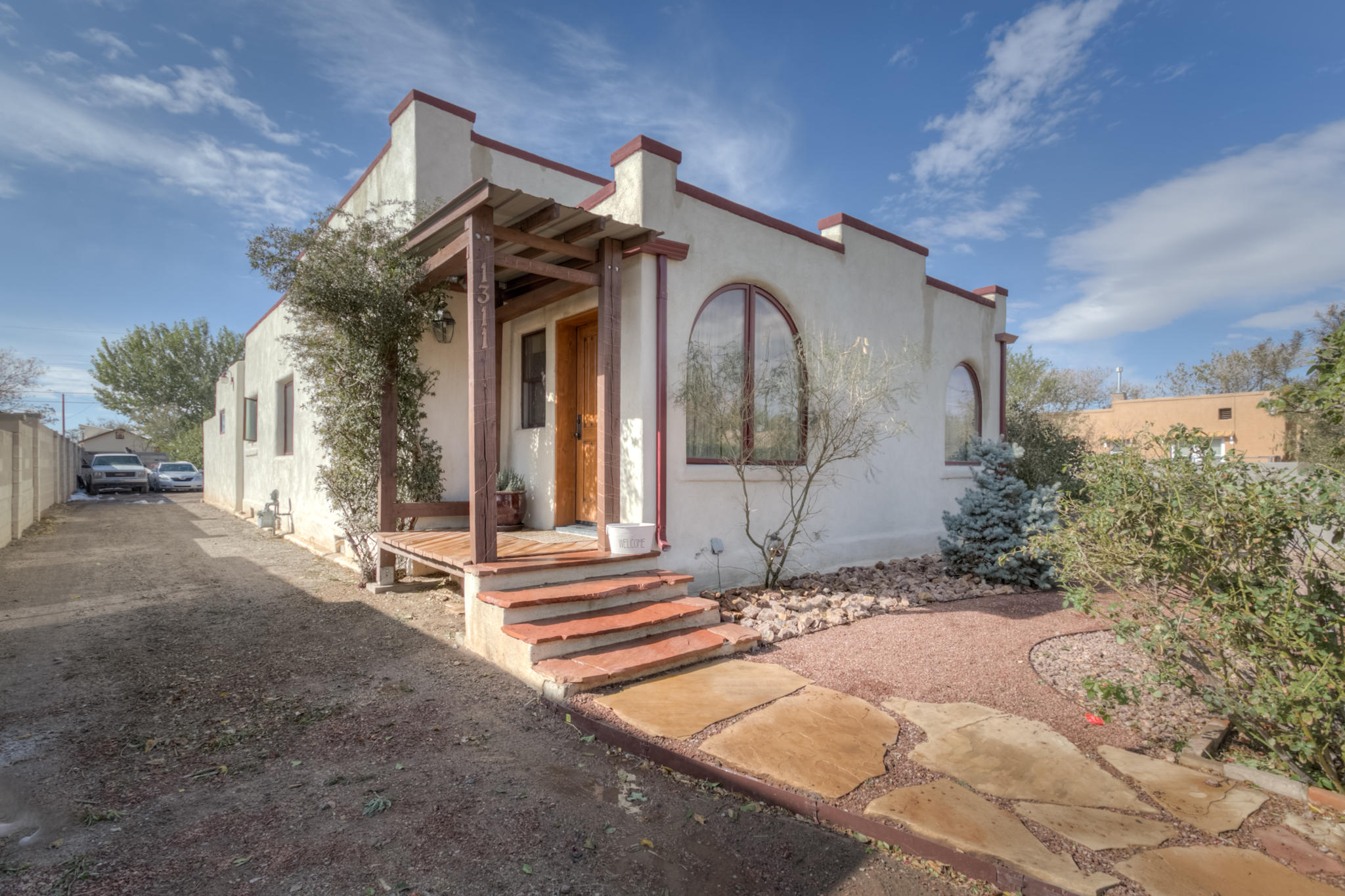 Beautifully updated adobe home in Downtown/Old Town area! Enter through the private front gate, lined with lush rose bushes! The foyer bright and warm... follow the hardwood floors to the open living area where you can cozy up to the wood burning stove. The kitchen is meticulous with custom cherrywood cabinets and granite to match, adorned with a farmhouse sink. There are two bathrooms and 2 bedrooms or utilize one for a home office. The back deck is great for entertaining and backyard is private and spacious and ready for your finishing touches.Location, location, location - close to Old Town, shopping, restaurants, and all the Sawmill district has to offer. Also easy access to I40.