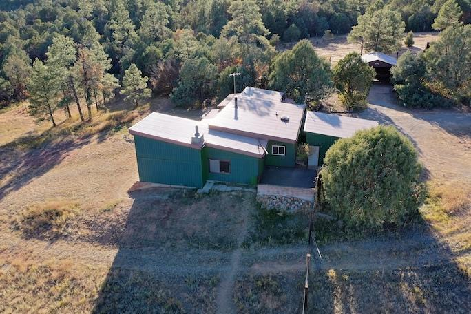 Wonderful secluded 8 acre horse property next to the Cibola National Forest. Passive Solar heating and two wood stoves keeps your heating bill low. Located at the end of the road creating a private oasis with breathtaking views! Plenty of potential inside and out. Stables with a a big Barn plus a round pen.