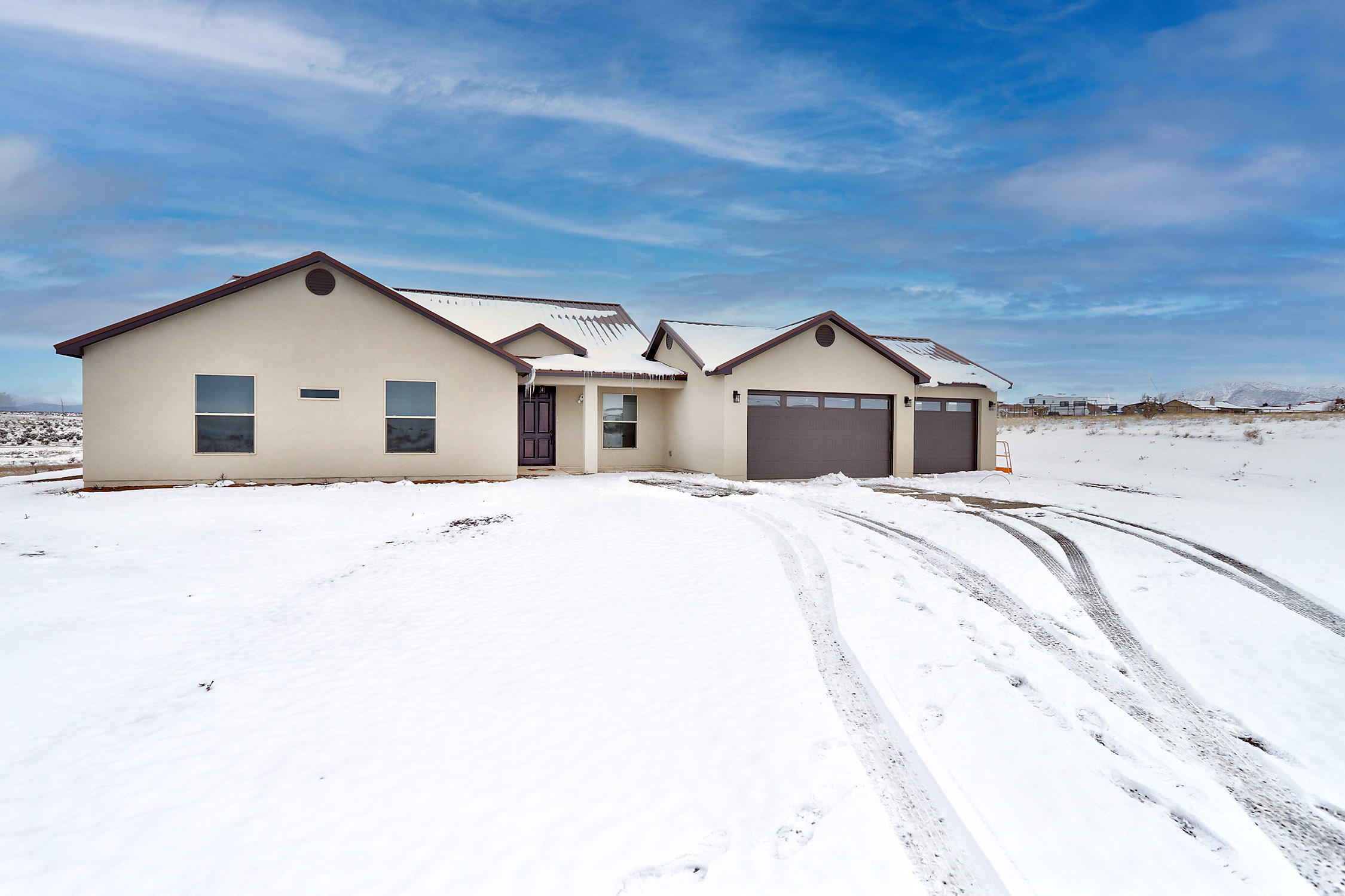 BRAND NEW Custom home! This home was completed in March of 2020. Offers 1 acre of land for all your toys etc, Located at the bottom of the cul-de-sac, Prime location!! 25 mins from ABQ. Features Open Floor Plan, 3 bedroom, 2 bath, tile wood planks throughout, oversized master bath/closet and a 3 car oversized garage! Could be used as workshop as well. Home is very private and cozy . Schedule your private showing today !