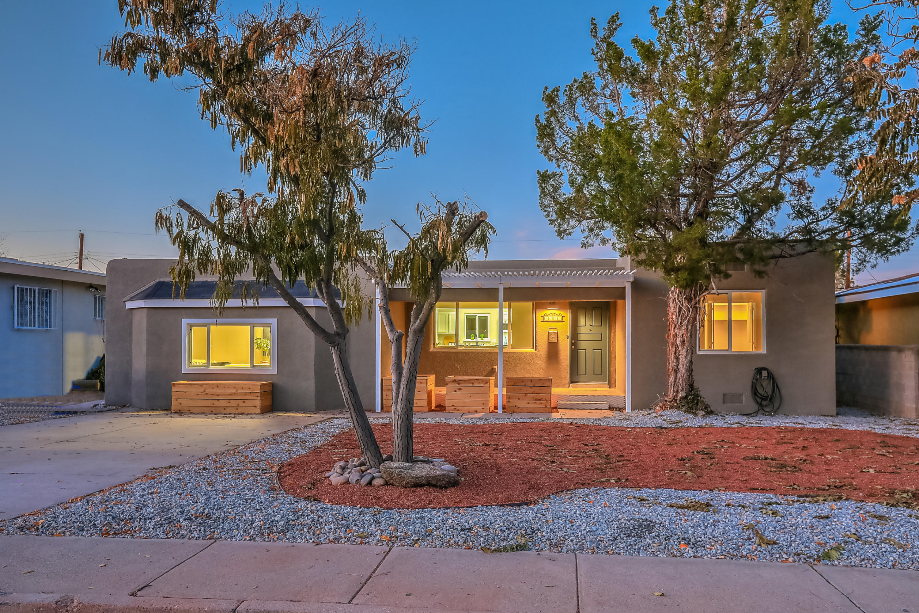 Cool modern feel, with a neighborhood of green trees and Nob Hill lifestyle living.  Come enjoy this amazingly updated and remodeled 1718 sq, double living area dream home.  3107 steps from historic RT66, dinning, coffee and amazing ABQ history.  Refinished floors, new tile, cabinets, windows and much much more.  Priced to sell and move in ready!!