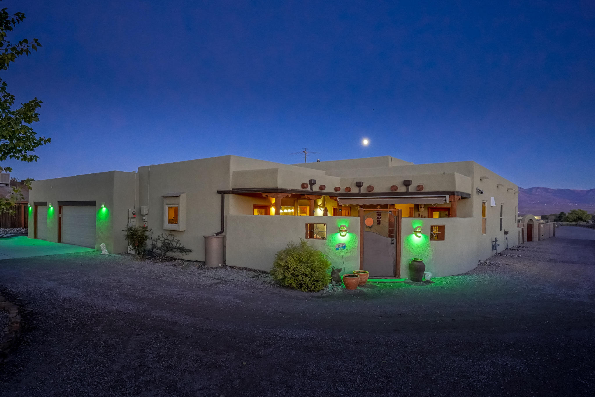 Come see this beautiful one story home with lovely curb appeal in Corrales. This southwest style home has OWNED SOLAR and features an inviting courtyard entry. The kitchen has pretty granite countertops and stainless appliances. The living room has beautiful wood beamed ceilings, tile flooring, a kiva fireplace, and a pellet stove to keep cozy on those cold days. There are dutch doors, skylights, and several private entrances. Through the backdoor is an amazing covered patio that leads into the backyard paradise with the most fantastic views. This incredible backyard is great for BBQ's or just relaxing on a cool NM evening. There are 4 bedrooms, 3 bathrooms, an oversized 3 car garage with a workshop area, RV pad, plus a bonus climate controlled room for groceries or added storage.