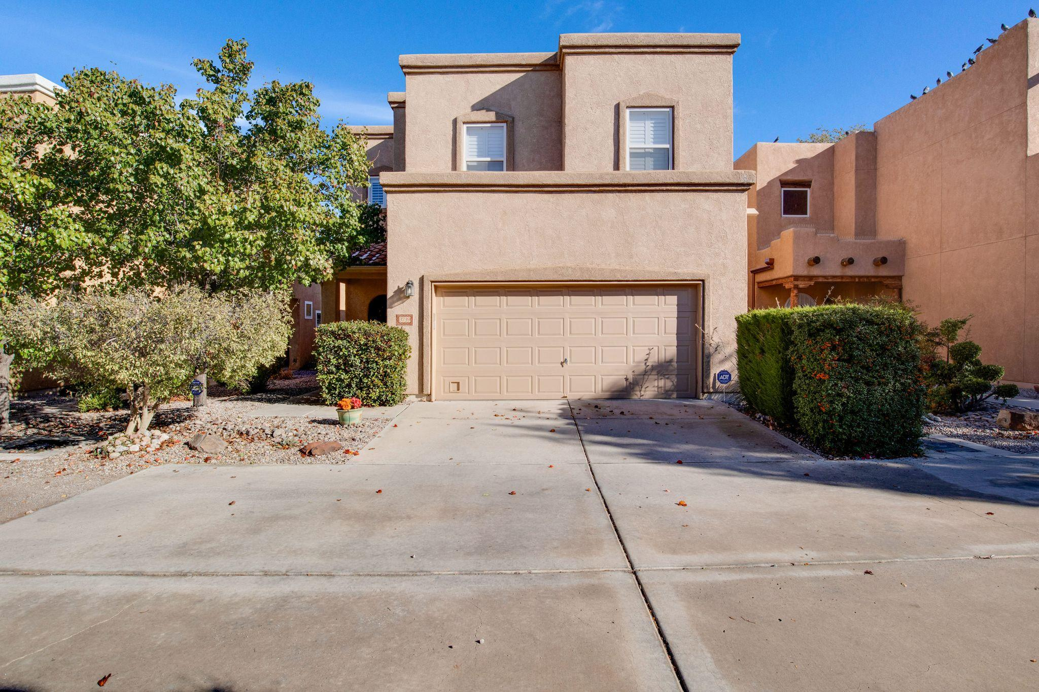 Located in the gated community of Los Candelarias in the heart of the North Valley! Close to shopping, downtown and UNM. Newly updated kitchen includes granite counters, faucet, double oven, dishwasher, cooktop, microwave - all one month old! Newer carpet and HVAC. Main Floor Owners suite with walk-in closet, en-suite bath with double vanity, separate shower & garden tub!  Downstairs half bath for guests. Special touches throughout such as custom paint, plantation shutters on all windows & back sliding door, nichos, wood beams and accents, custom front door, alarm system, electric fireplace for ambience. Upstairs there is a sizeable loft that could be used for an office or hobby space. Plenty of storage throughout and backyard shed stays!  HOA covers gate & trash/recycling pick up.