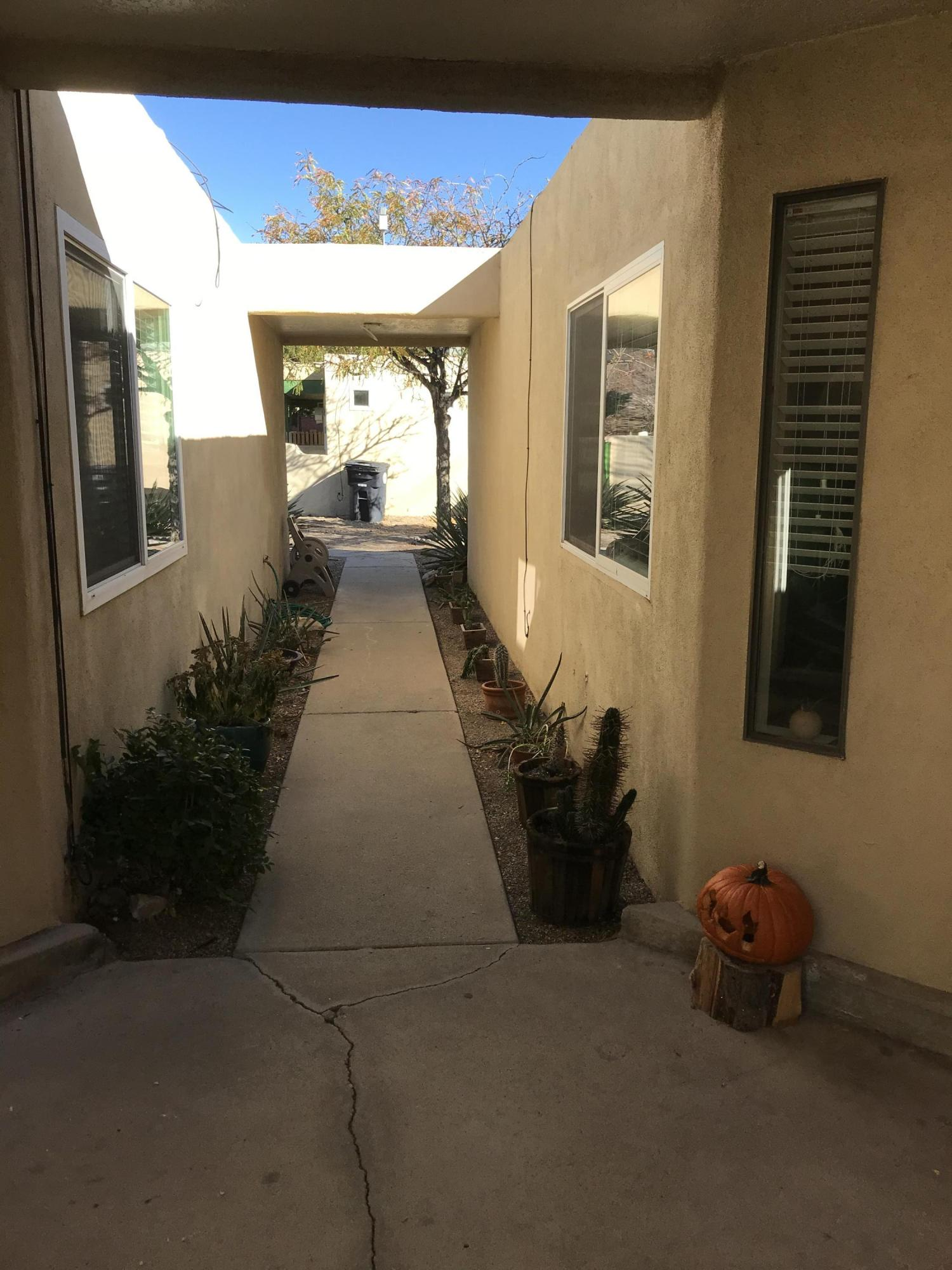 Own for less than you can rent!  Smart, detailed Two Bedroom condo with color and class.  Kitchen has Butcher Box and Stone counter tops, pantry and Skylight.  All appliances stay!  Woodburning fireplace.  Private Back patio with sunshade.  New Roof. Insulated non-joining wall to neighbor.  Don't miss out on an opportunity to own this adorable condo.