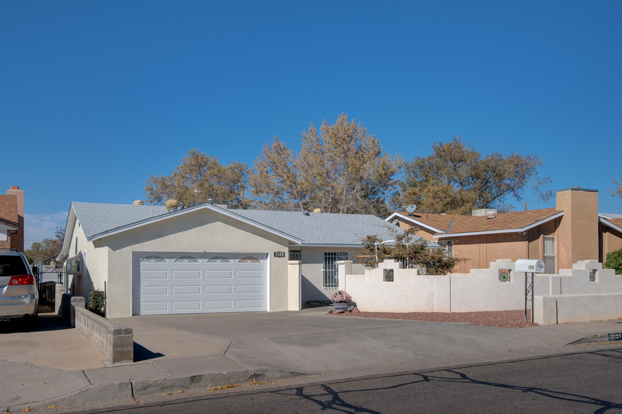 Home for the Holidays!! MOVE-IN Ready!  Sellers have upgraded 3BR 2BA 2AG home over the years- kitchen w/ new cabinets and SS appliances, gas range 3+ovens, double dishwasher,tile floors, 200 amp service w/ new copper wiring and misc. elec. features not found in most homes (See Features List), Exterior windows are double pane w/ brand new screens. 12'x35' covered parking for RV w/backyard access. 10'x16' Tuff Shed w/loft, elec. service  w/great possibilities.  New Roof, Stucco, Hot Water Heater and exterior paint Aug 2020.  Interior paint and New Carpet Sept 2020.  Heated/cooled Solarium w/wood burning stove and beautiful brick floor serves as family room year round.   Hurry and schedule an appointment to view today!