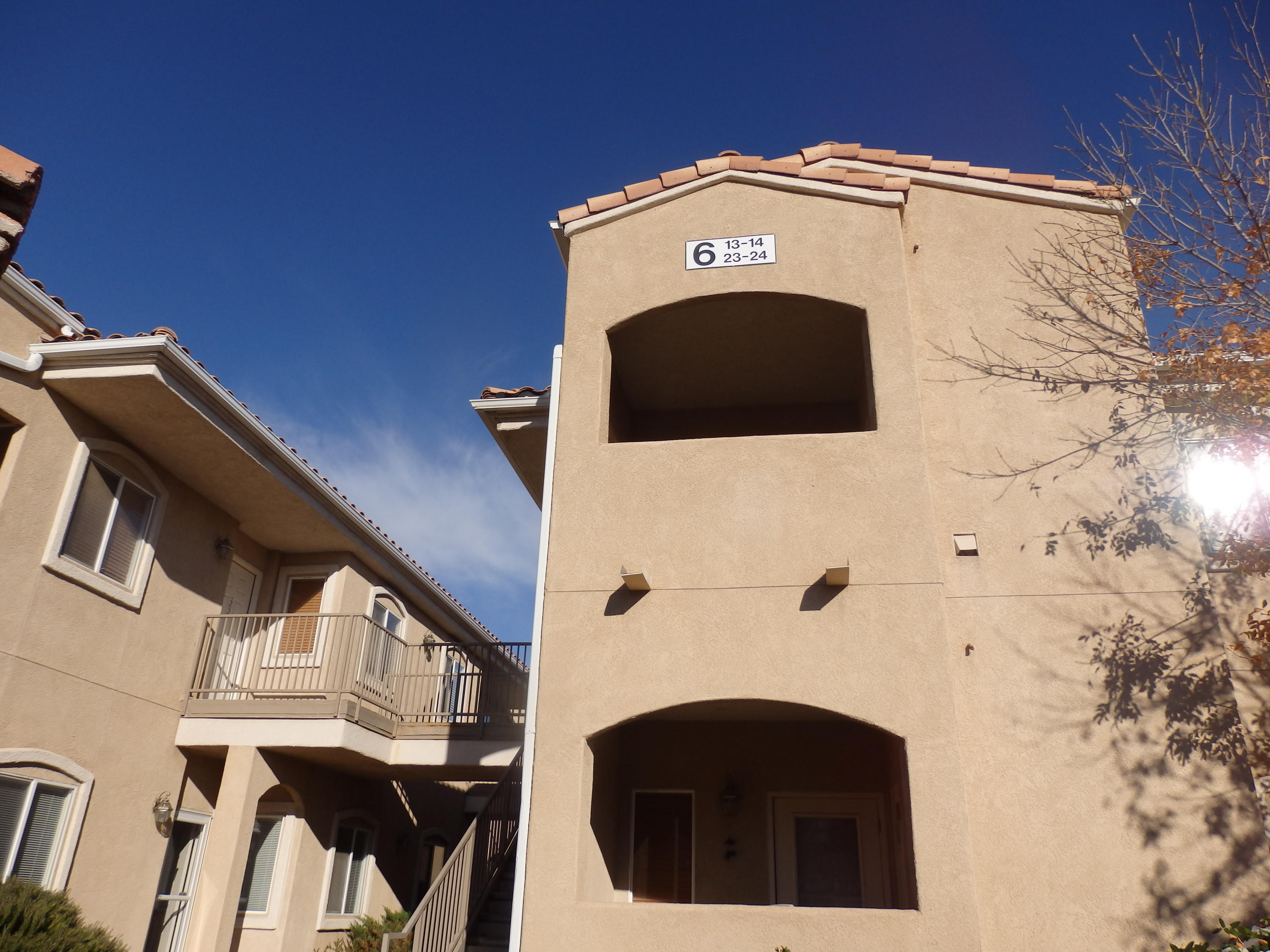 Three bedroom upstairs unit. Clean and neat. View of Sandias From balcony. Move in ready.