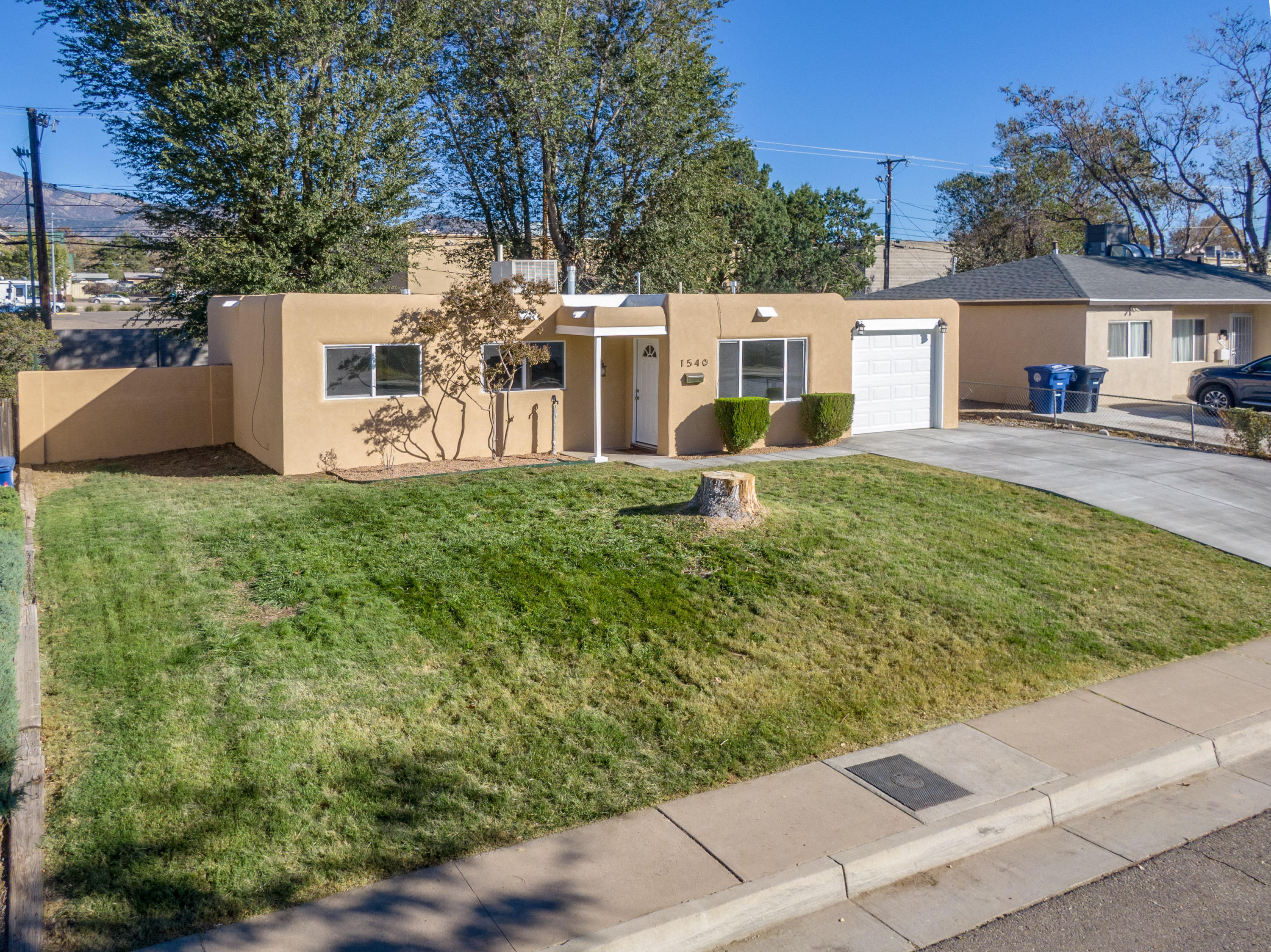 Welcome to this Bright, Beautiful, Completely Remodeled, Move-in Ready Home in Northeast Albuquerque! 1540 Glorieta features a New TPO Roof, New Synthetic Stucco, New Windows and Solid-Core Doors! The Kitchen offers New Granite Counters, Brand-New Samsung Stainless Appliances, New Cabinetry, Breakfast Bar, and a Striking View of the Sandias! The Renovated Full-Bath presents New Custom Cabinetry with Soft-Close Drawers, Granite Countertop/Backsplash, New Tile, and New Bathtub! Lifeproof Waterproof Luxury Vinyl Flooring Throughout. No Carpet! Fresh Paint Throughout. 1540 Glorieta presents you with a Large, Green, Grassy Backyard w/ Mature Shade Trees, Mountain Views, New Concrete Patio, Raised Block Walls for Privacy, Storage Shed. Conveniently Located in NE ABQ w/ Easy Access to Everything!