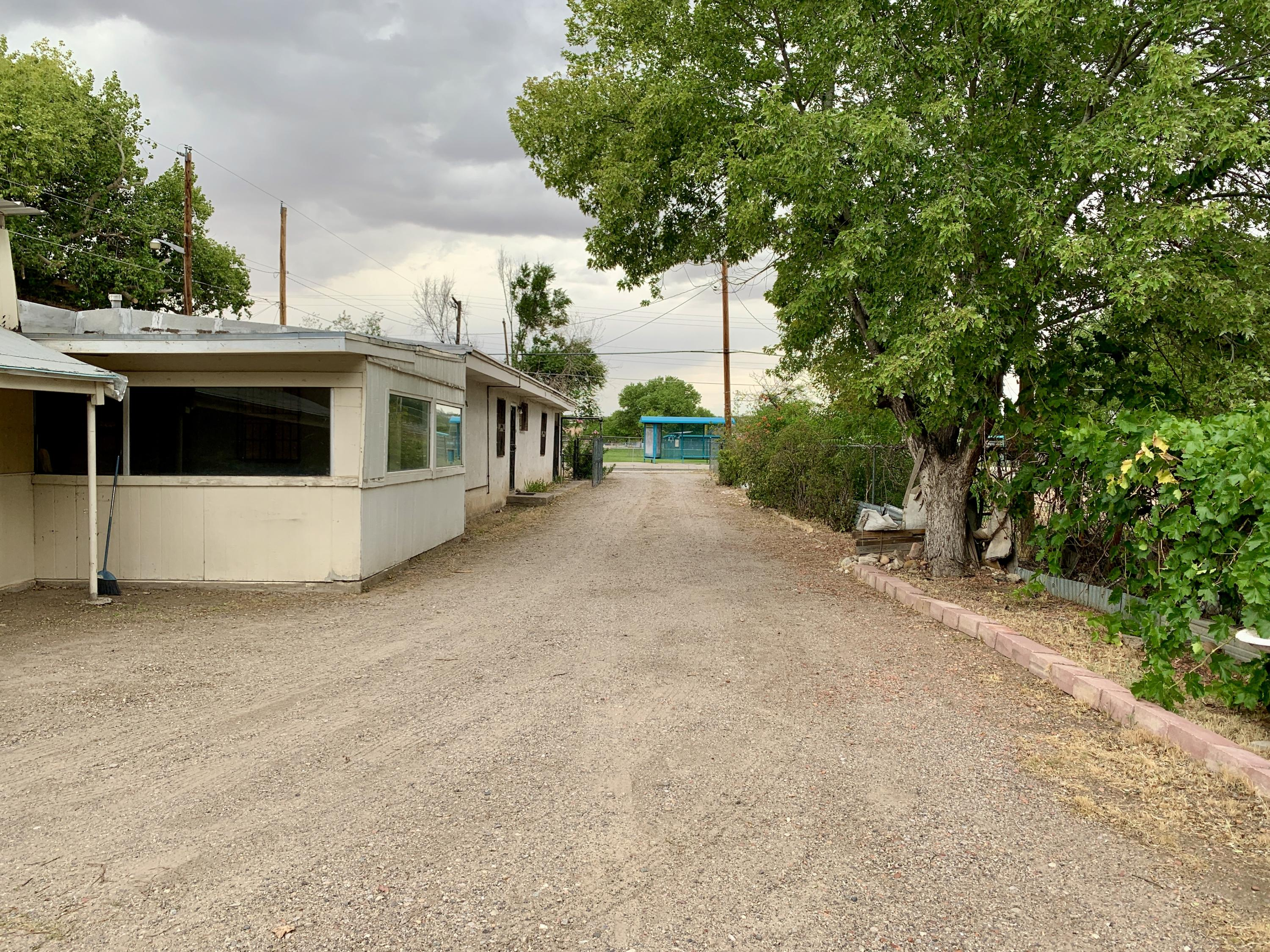 Nestled in Vecinos Del Bosque neighborhood and just minutes away from shopping, Albuquerque Bio Park, Old Town, downtown and across the street from Atrisco Park. A nice sized homesite that provides room to add on or for gardening.  This spacious yard also includes a fully fenced yard - great for pets and kids.