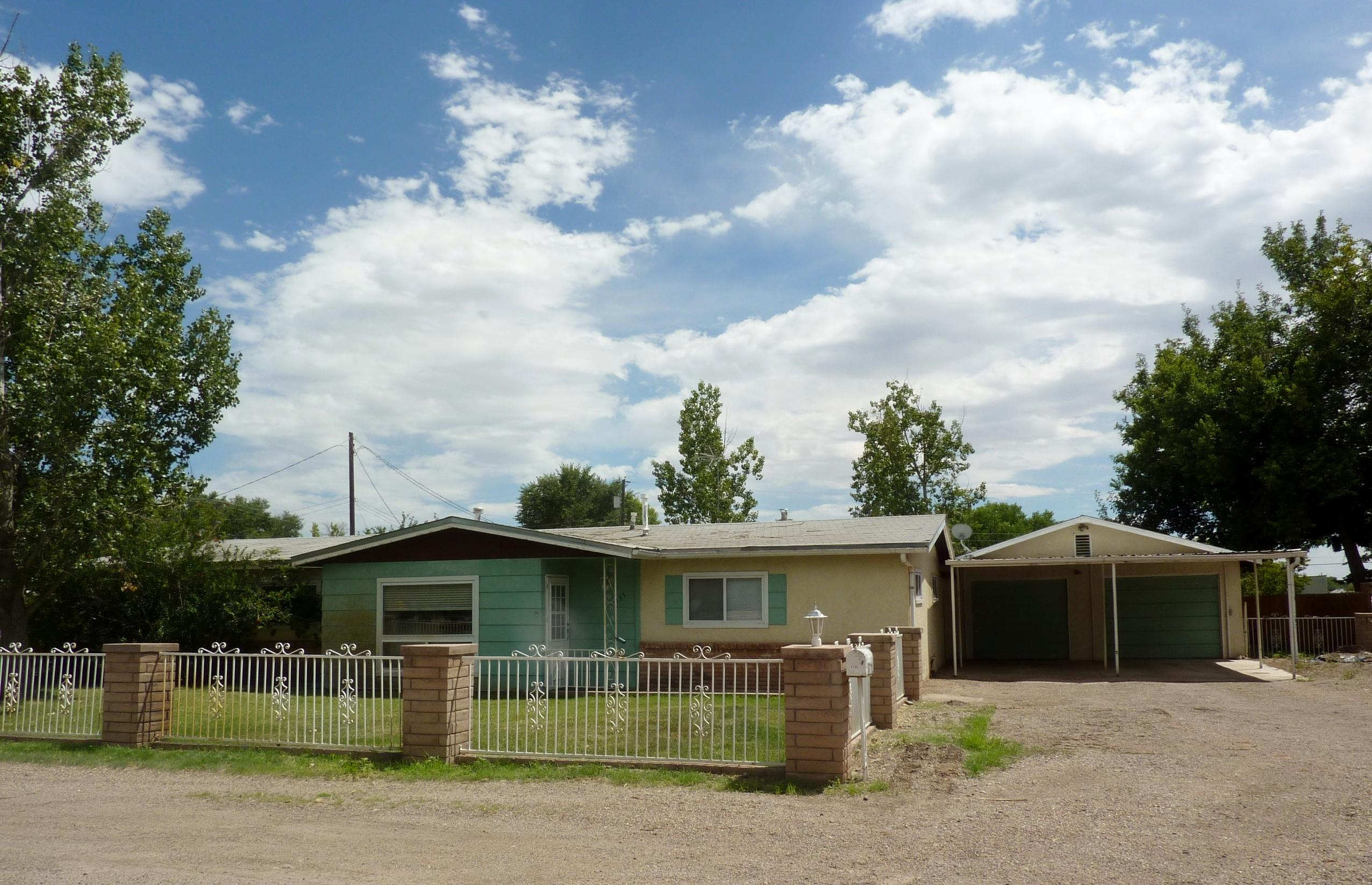 Plenty of space on this 3 or 4BR 1.5BA home on 1/2 Acre in Bosque Farms. Home updates but has a lot to offer. Features 2 living areas with a wood burning fireplace and a wood stove. Open floor plan. Detached shop measures 26X35 and has a lift. Property also has a 12X20 Artist studio (with A/C & Heat-no water). Detached garage 24X38 with storage. Barn with small stall & storage. Carport. Covered Patio. Plenty of potential on this home. City water & sewer plus irrigation well. New HW heater, kitchen cabinets and roof will be replaced before closing.