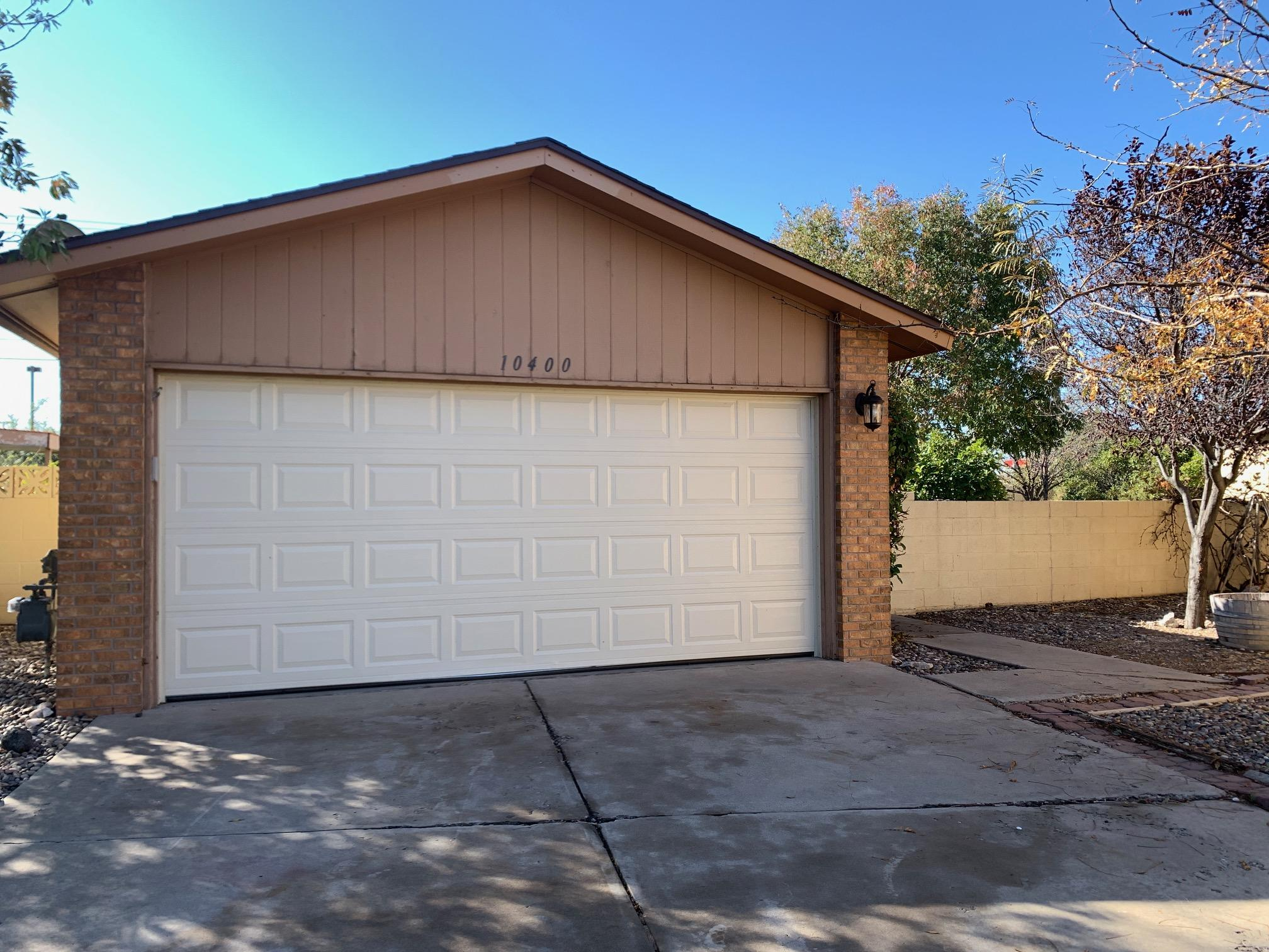 This 2 bedroom, 2 bath home is located in the gated Towne Park community and is close to shopping and restaurants, as well as Sandia Labs & KAFB. There is a fireplace for those chilly winter evenings and the lot is one of the larger ones in the neighborhood. 2 car detached garage. Community amenities include walking trails, pools, tennis courts, parks & playgrounds. The HOA covers front yard maintenance. This home is on leased land - the land can be purchased from the HOA for $27,000 or leased for $125/month. HOA fee is $115/month and water is billed to home owners per their usage. Agents please review all MLS attachments.