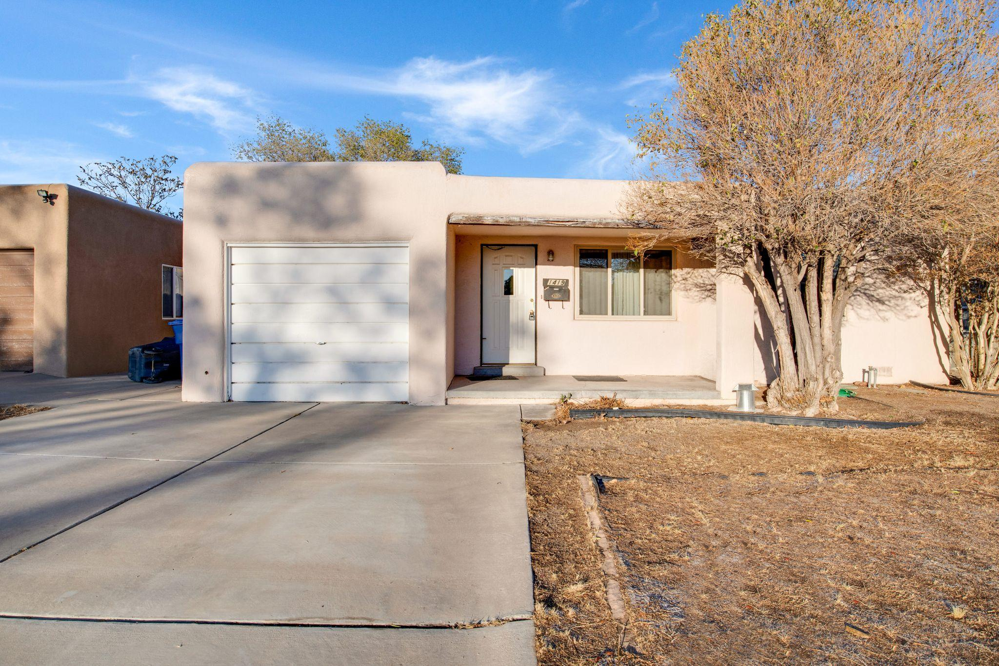Lots of potential in this 1 owner home located in the desirable UNM area.  The home has a newer roof TPO roof 11/2018, double pane windows, some original hardwood floors, synthetic stucco &  CF heating/refrigerated air. 3 possible living areas, 3 bedrooms & a possible study or office off the master. Large backyard with a wonderful storage building. Summit Park & Montezuma Elementary is just down the street. Close to UNM Hospital, UNM North Golf course & UNM Medical & Law Schools.  Easy access to Whole Foods, Smith's, shopping, restaurants, I-40 & I-25. There are rooms where the carpet has been pulled up and ready for your imagination.  There are lots of possibilities to make this one your own! Make sure to check out the Virtual Tour!