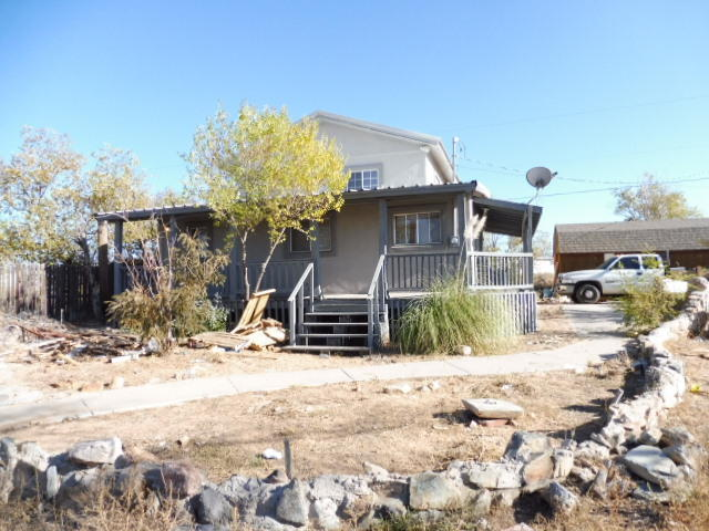 Two- Story 3 bedroom 2 bath 1977 sq.ft. Ranch style  home, some wood beams and wood ceilings , rock wall. On 1 acre, also includes a 12'x32' shed .
