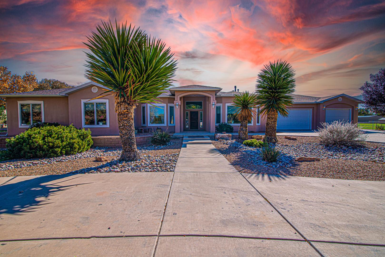 Beautiful custom home on 2 irrigated acres in Bosque Farms!  This home offers 4098 sq ft, 4 bedrooms, 2 full +3/4 +1/2 baths (total 4)  plus a game room with a wet bar, and a workout room.  Central vac system, radiant heat, 2 hot water heaters, 2 refrigerated air units.  Huge family room with cathedral ceilings.  Covered patio is 964 sq ft across the entire back of the home and opens onto beautiful yard with in-ground heated swimming pool.  Yard is beautifully landscaped and on sprinklers with a gazebo w/half bath for relaxing by the pool.  3-car attached garage plus a 3-car RV garage/workshop & attached carport.  City water, City sewer & irrigation well.  Bring your animals and your toys and come to the peace & quiet of Bosque Farms.  Easy access to I-25 and minutes to Albuquerque