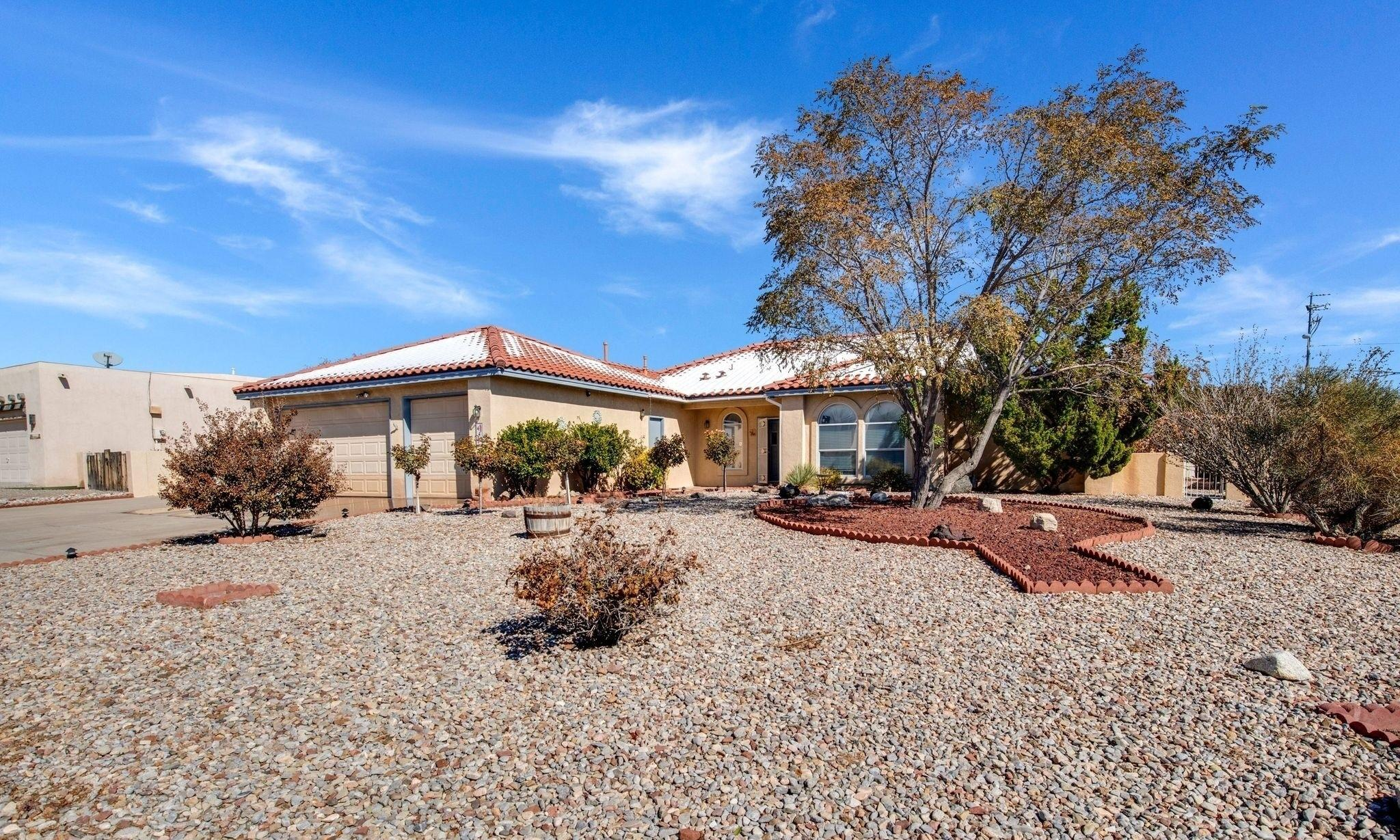 This single-owner home has been lovingly cared for and is ready for you to move in.  The light and bright home boasts a HUGE OPEN KITCHEN with island, breakfast nook and breakfast bar that is open to the second living area. The home's extra large bedrooms are a welcome sight! The 1/3 acre corner lot and backyard is a gardener's paradise with drip systems, multiple fruit trees, grapevines, vegetable garden and shed.  The large covered patio, water feature, and gas grill hookup is perfect for entertaining.  The OVERSIZED GARAGE is a hobbyist's dream, with workbenches, storage cabinets and attic space. The side yard access and 54 ft RV PAD has electricity and sewer hookup. This one won't last!