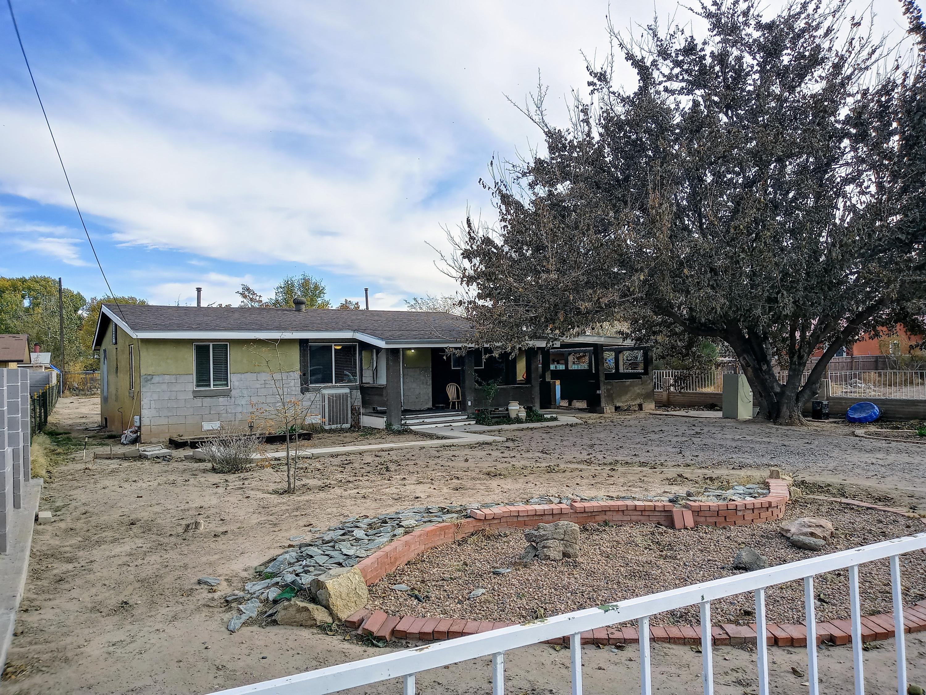 Just listed!! Large lot property in Southwest Albuquerque close to Rio Grande River area for a walk on the bosque. Three-bedroom one-bath home with newer flooring lots of potential on this property make an appointment today!